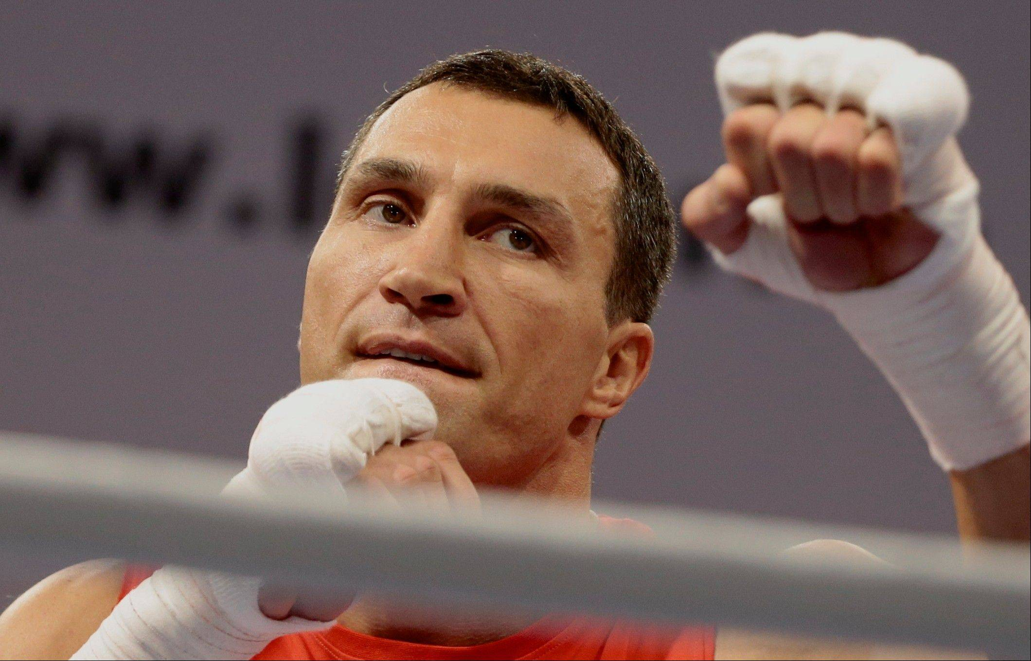 This is a Wednesday, Oct. 2, 2013 file photo of boxer Wladimir Klitschko of Ukraine attends an open training session in Moscow, Russia.Wladimir Klitschko will defend his WBA, IBF, WBO and IBO heavyweight titles against Australian challenger Alex Leapai in Oberhausen, Germany, on April 26.