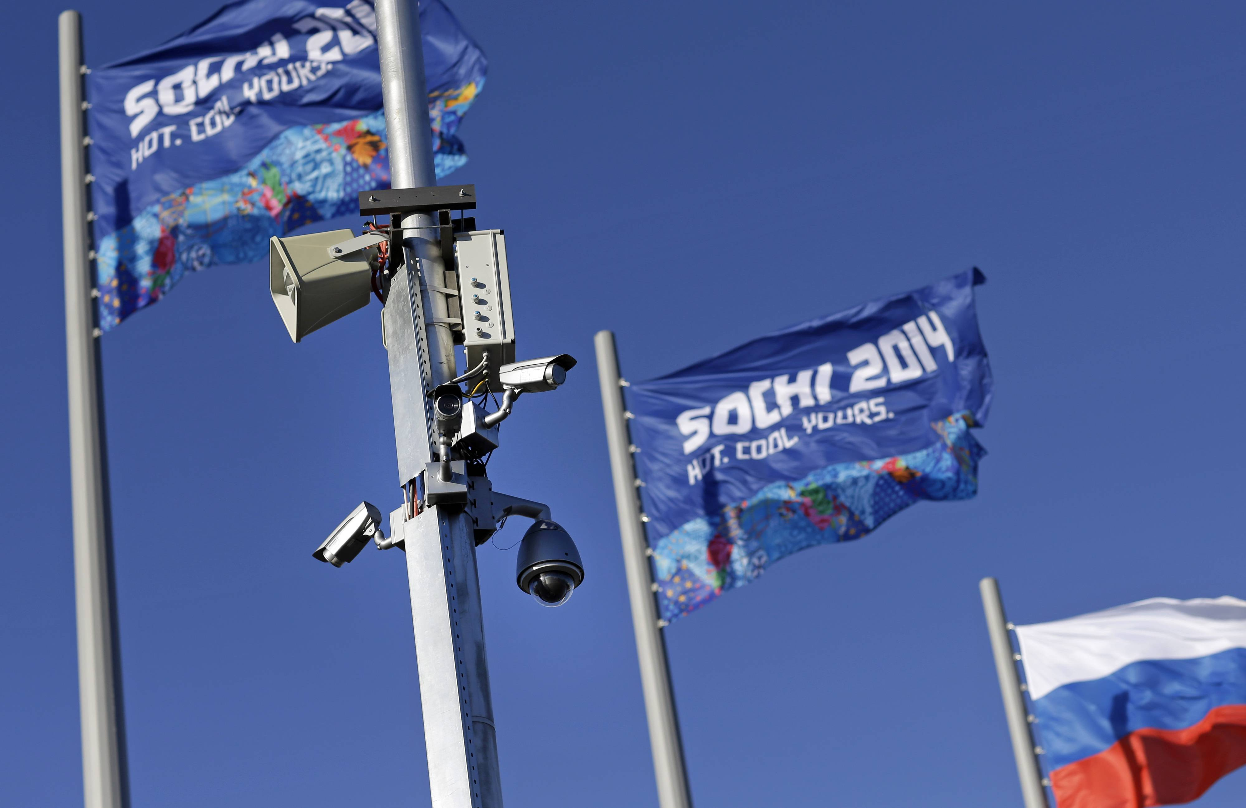 A bank of security cameras hang from a pole in Olympic Park as preparations take place for the 2014 Winter Olympics, Monday, Feb. 3, 2014, in Sochi, Russia. (AP Photo/Patrick Semansky)Bloomberg News