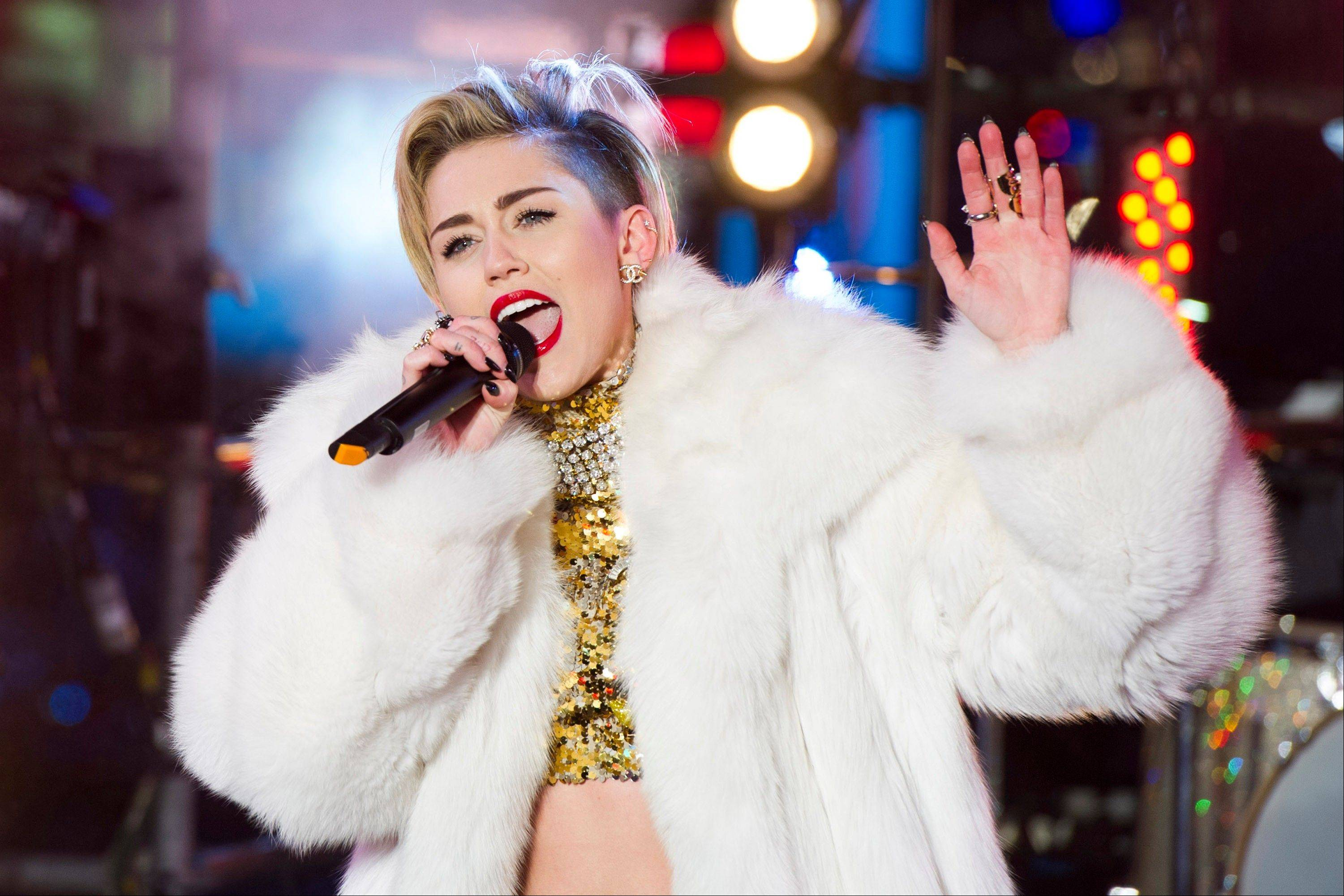 """Ren and Stimpy"" creator John Kricfalusi and contemporary artist Ben Jones have crafted videos to play during the 38 shows as Miley Cyrus prioritizes singing over dance routines in her new tour."