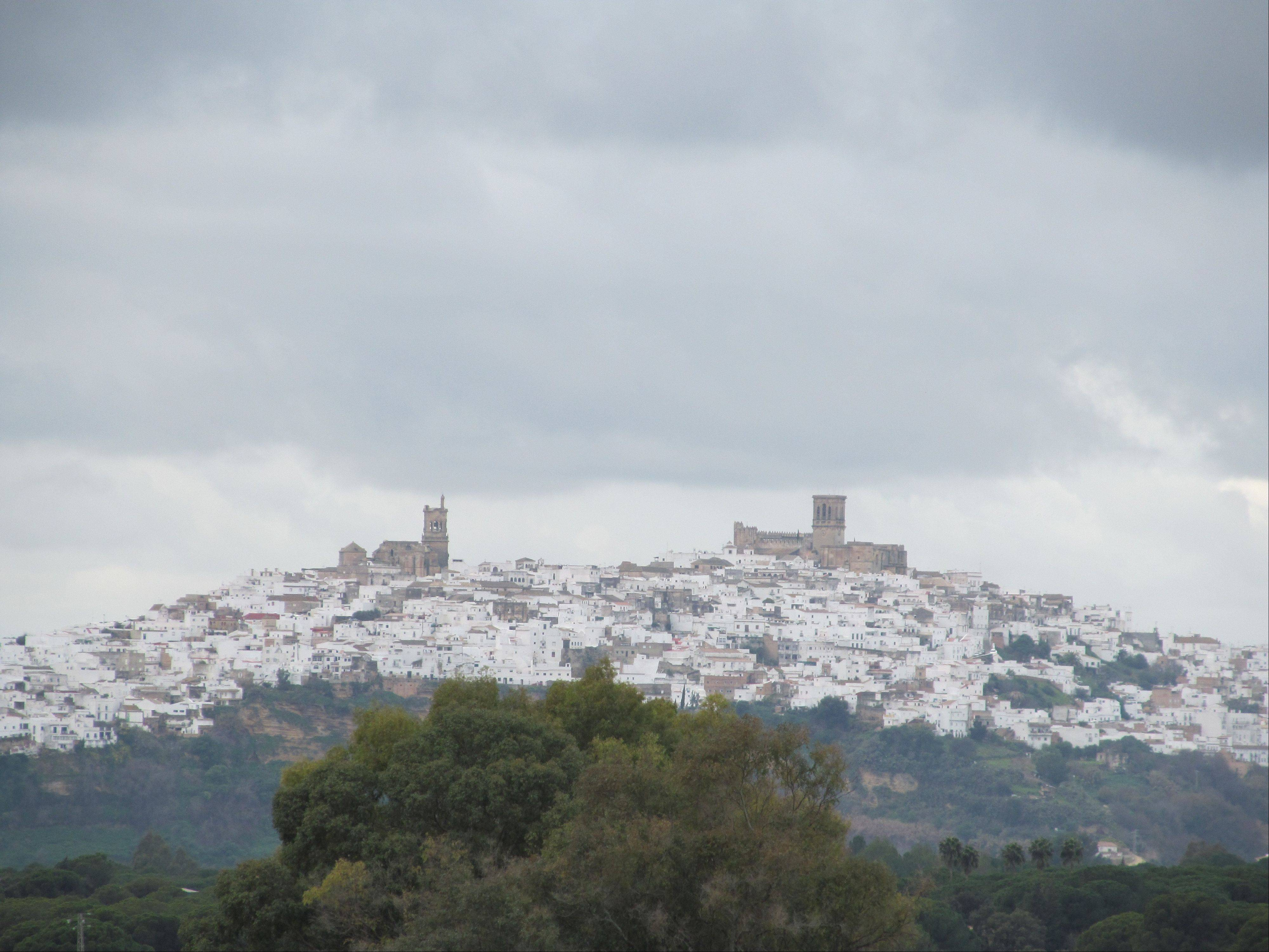 "Arcos de la Frontera is one of the most easily reachable of Spain's ""pueblos blancos,"" or white villages. The town, with monuments dating back from the 15th century, looms over Andalusia's farmland."