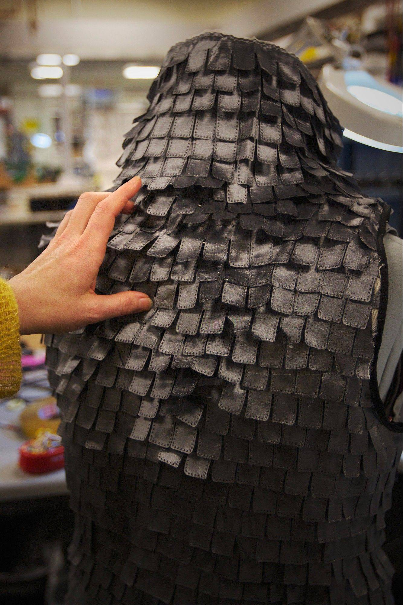 "A jacket that resembles a chain-mail vest has bendable, wired ""leaves"" that flap when the wearer is happy."