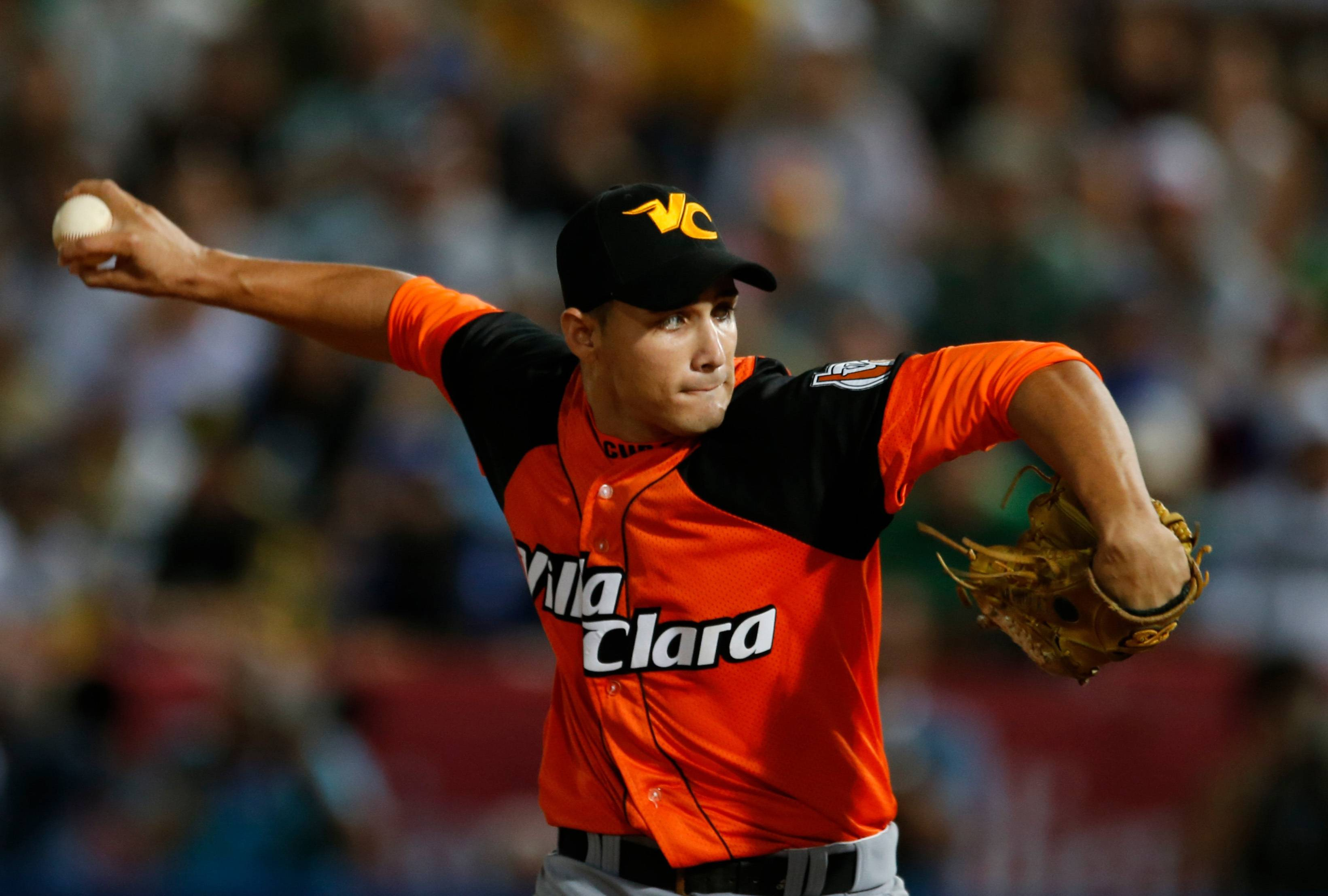 Cuba starting pitcher Norge Ruiz pitches Sunday during the first inning of the Caribbean Series baseball game against Venezuela in Porlamar, Venezuela.  Associated Press