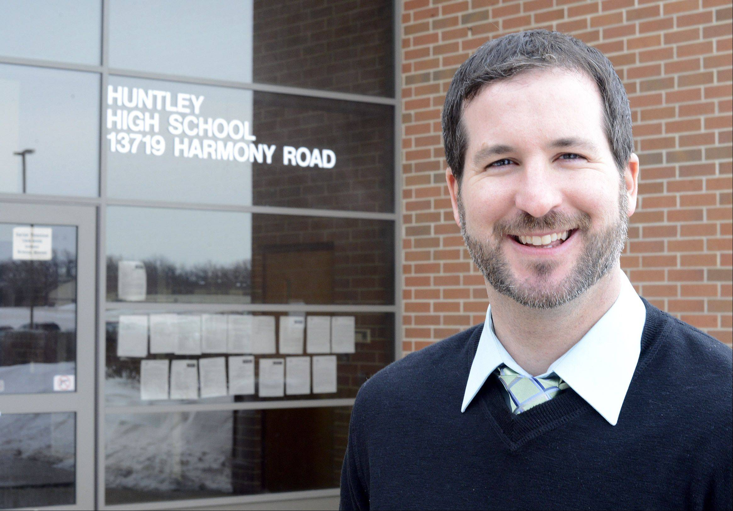 Huntley Police Officer Adam Dean, the village's new juvenile specialist, hopes to combat an increase in juvenile crimes by working with youths before they get into trouble.