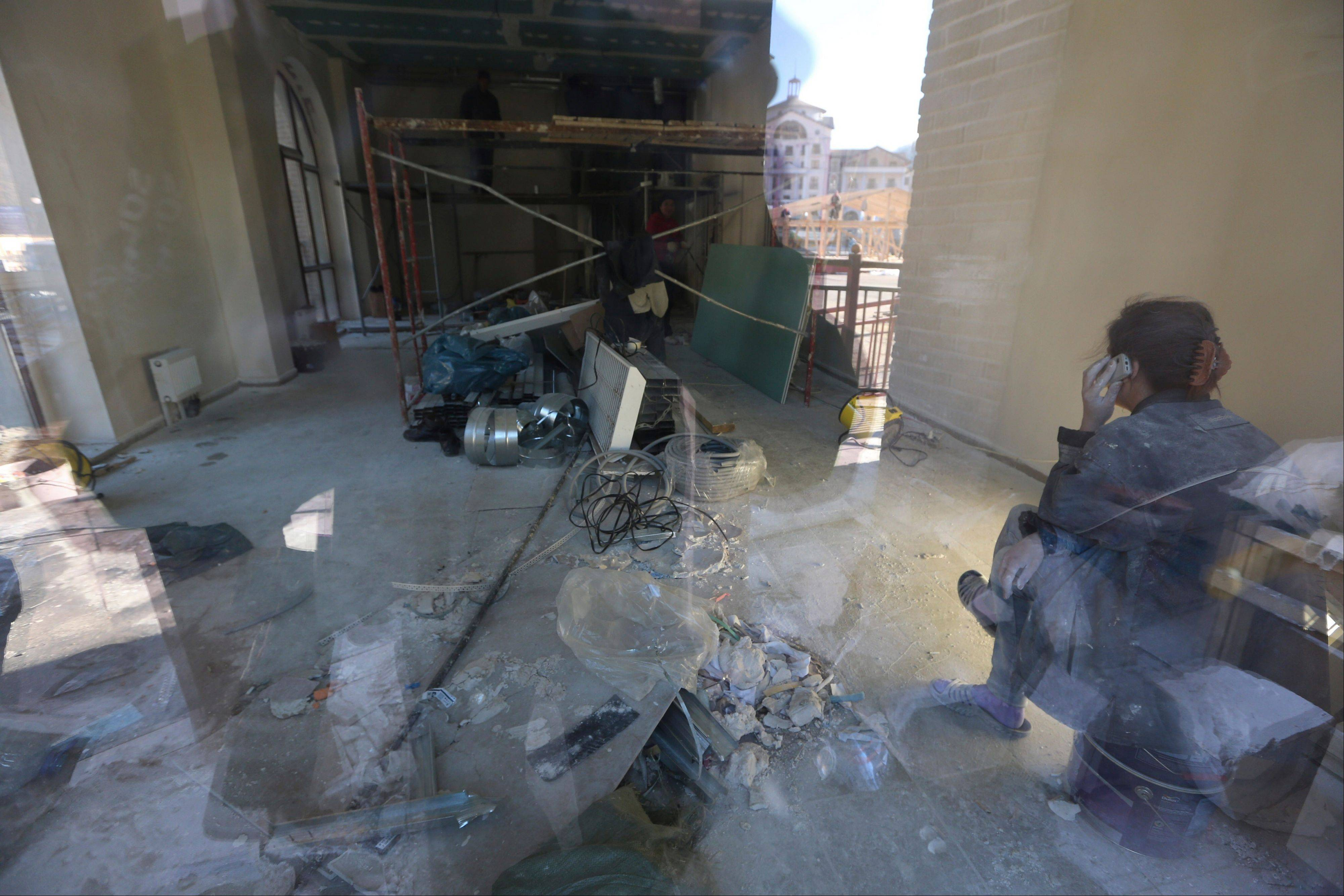 A view into an unfinished area of the Gorki Plaza East hotel in Krasnaya Polyana, Russia Sunday, Feb. 2, 2014. According to the 2014 Sochi Winter Olympic organizing committee, only six of the nine media hotels in the mountain area are fully operational.