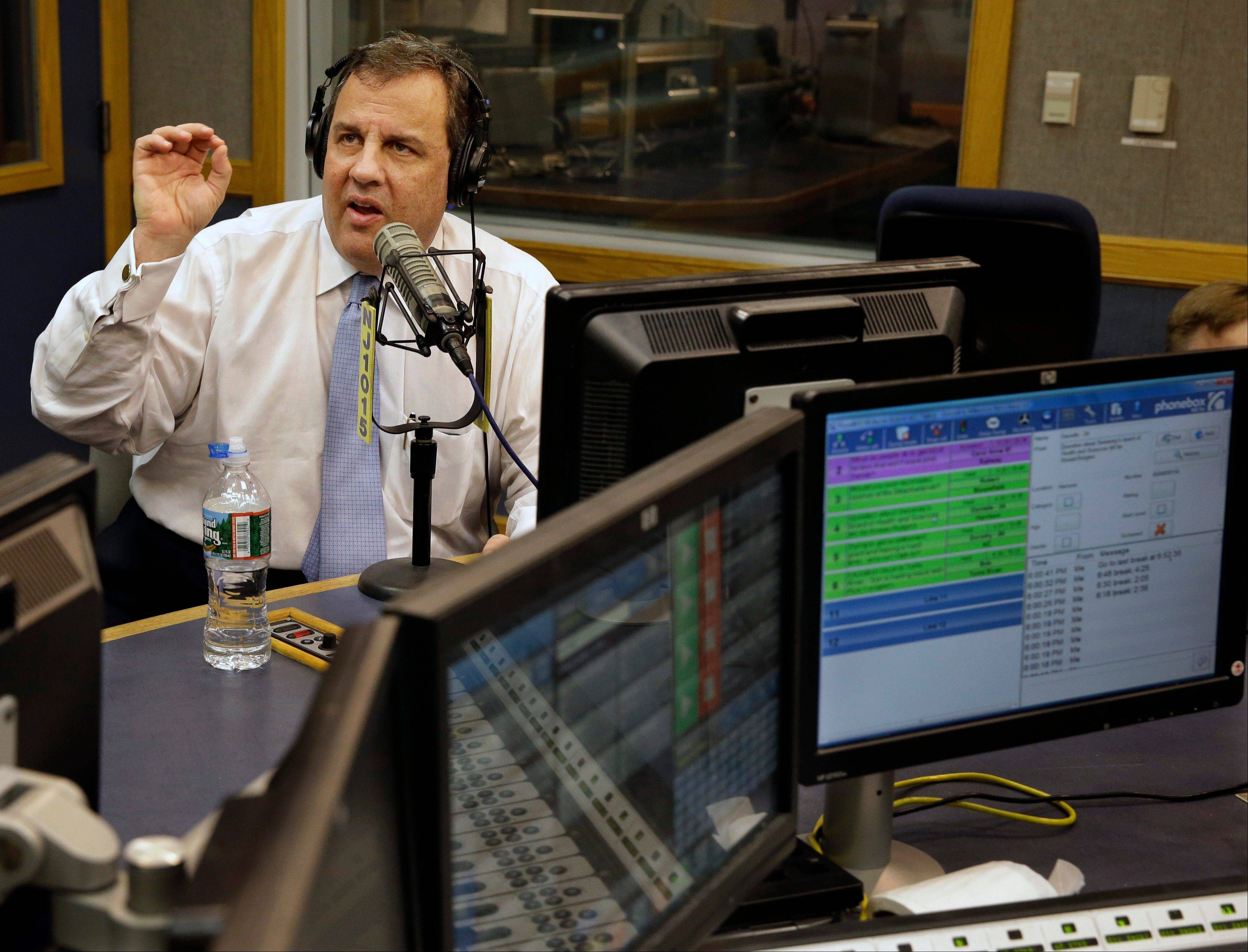 "New Jersey Gov. Chris Christie sits in a studio during his radio program, ""Ask the Governor"" broadcast Monday. During the program, Christie took questions from callers for the first time in more than three weeks as his campaign looked for a way to pay for lawyers as a political payback scandal continues."