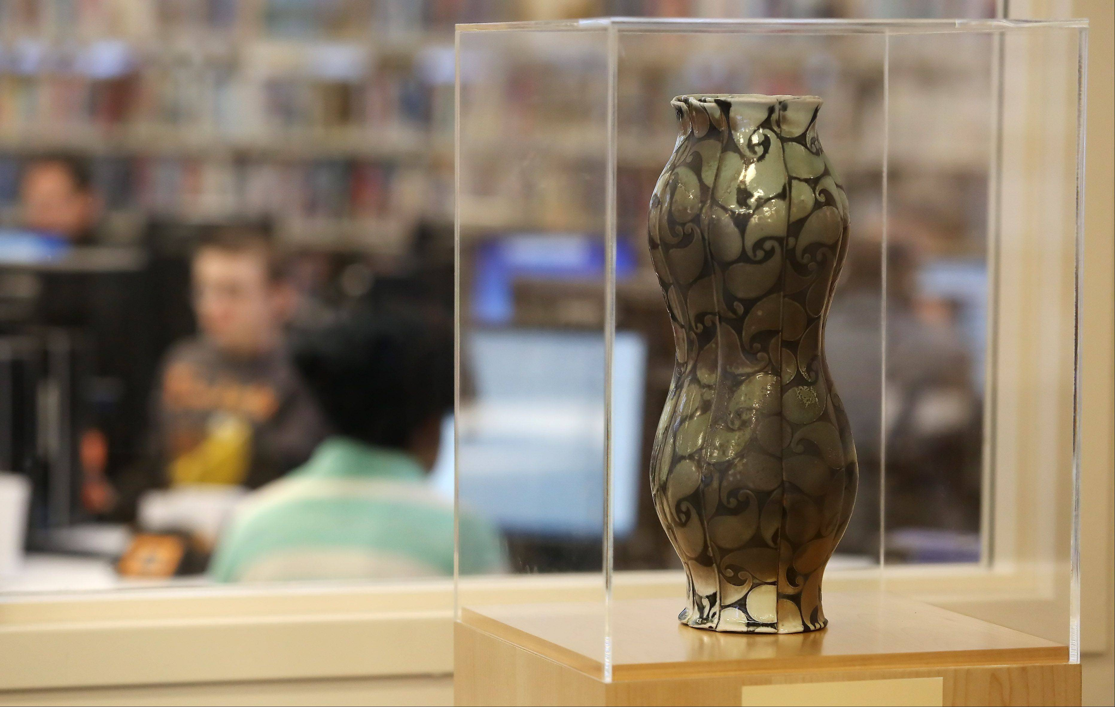 """Paisley Vase"" on display with other artwork on the walls at Warren-Newport Public Library in Gurnee. Library officials are seeking proposals for a new commissioned piece and also are planning to display student artwork."