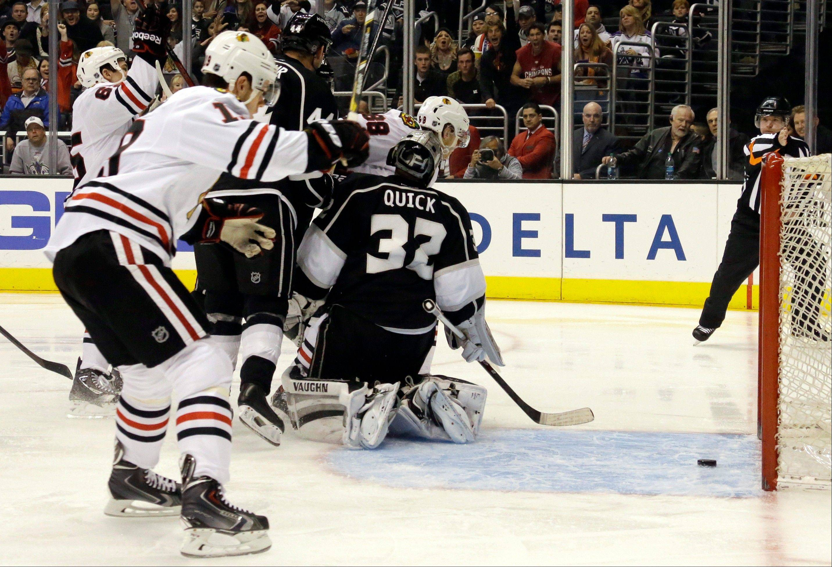 The Blackhawks' Jonathan Toews celebrates a goal by Patrick Kane, not shown, against Kings goalie Jonathan Quick in the first period Monday night.