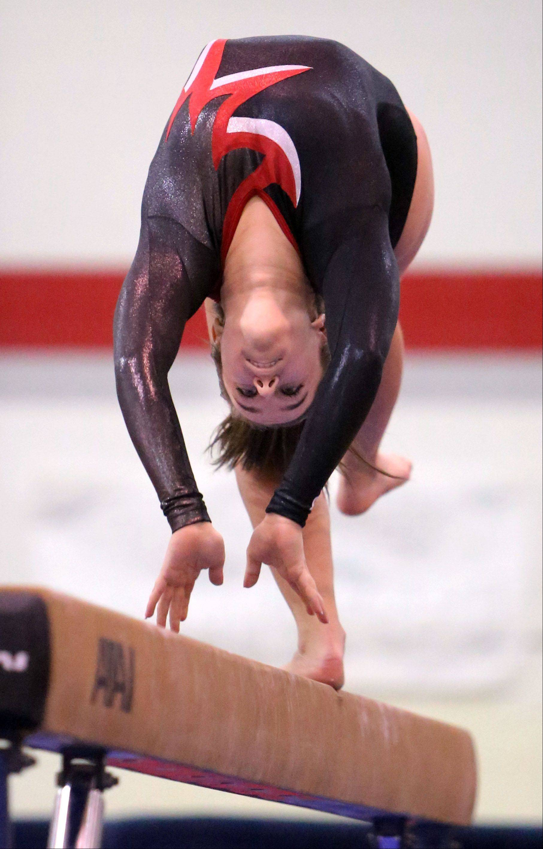 Mundelein's Nicole Ornoff competes on balance beam during Monday's regional at Mundelein.