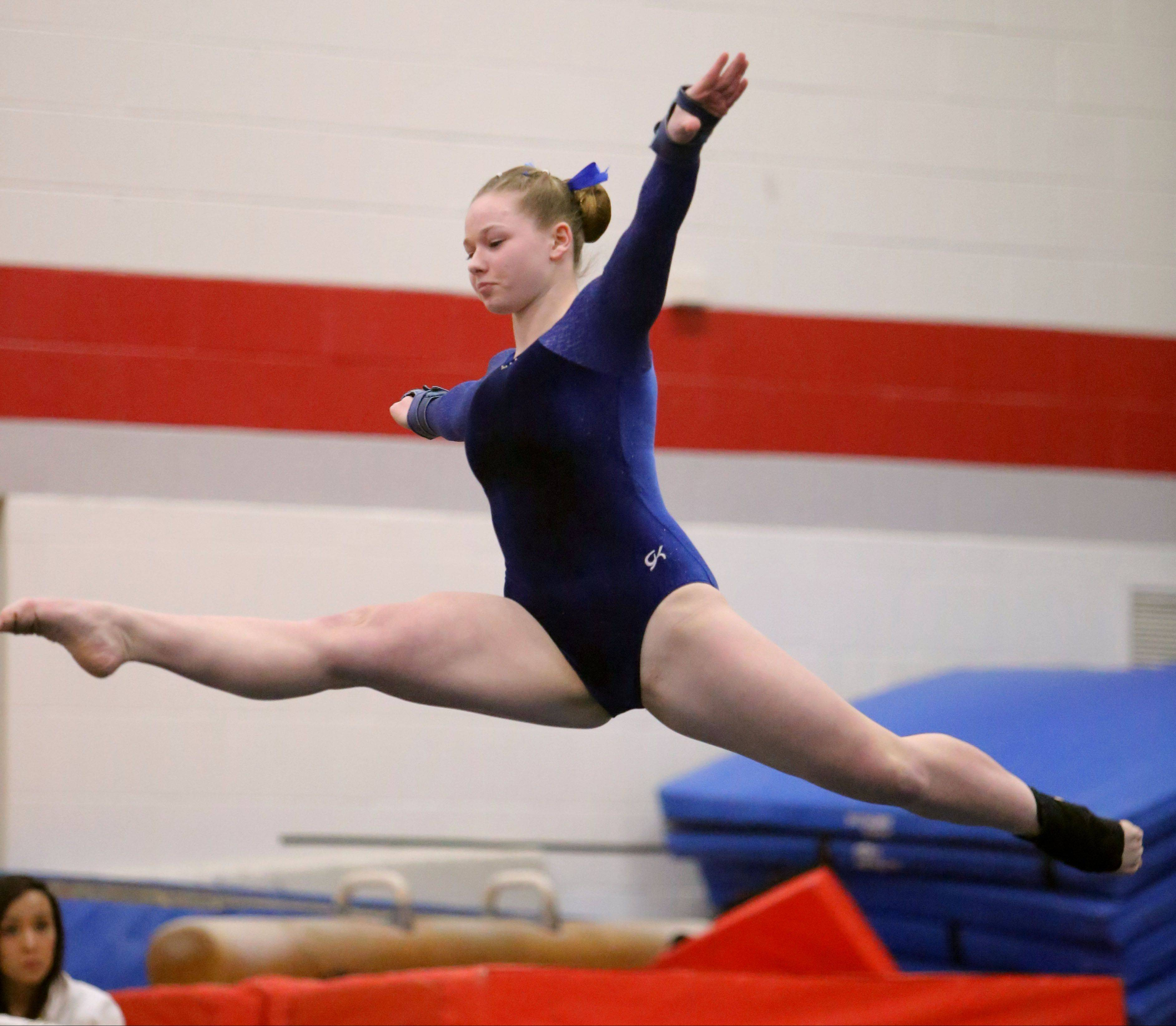 Lakes' Melissa Lemke competes on floor exercise during Monday's regional at Mundelein.