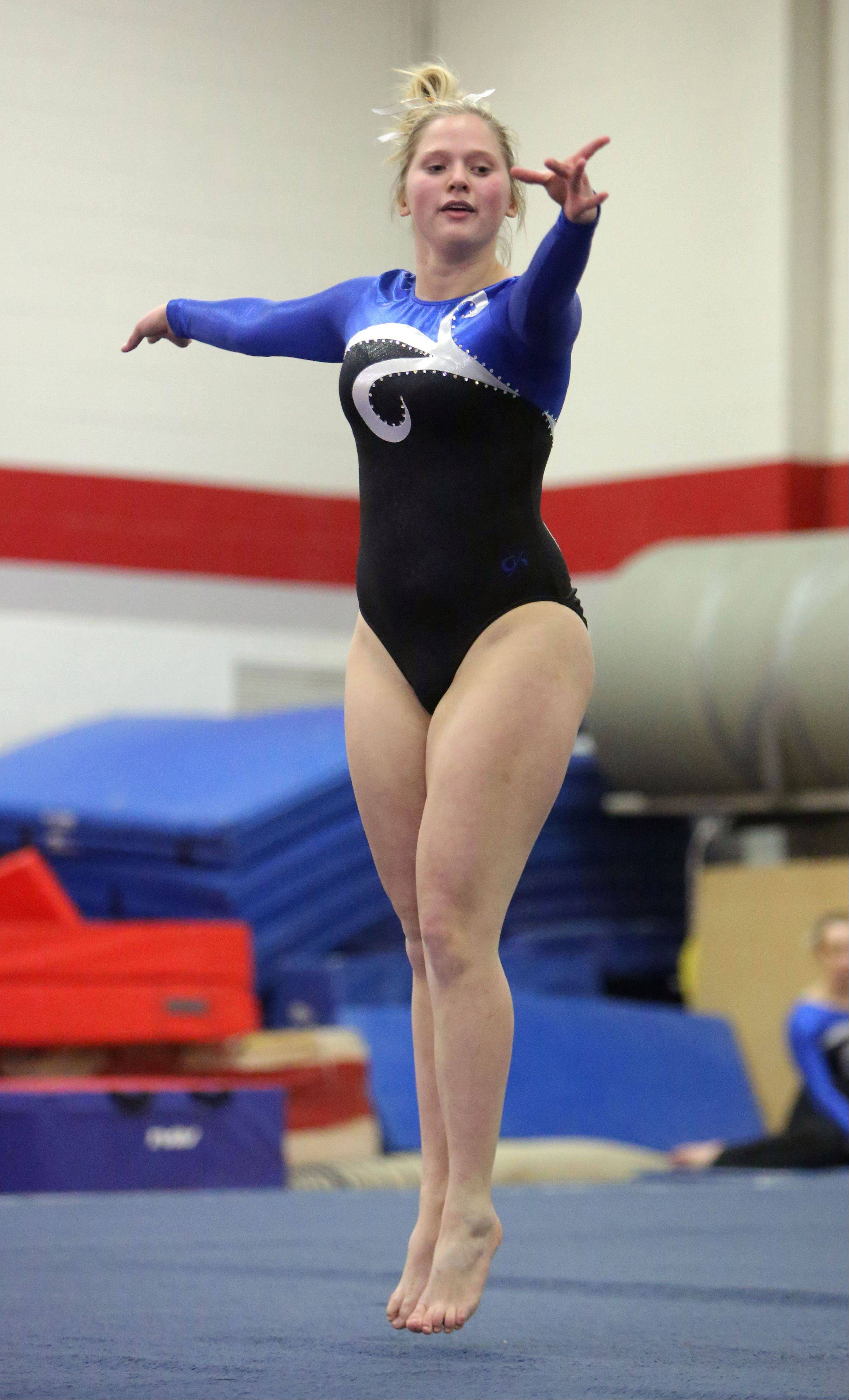 Wheeling's Lexy Scanlon competes on floor exercise during Monday's regional at Mundelein.