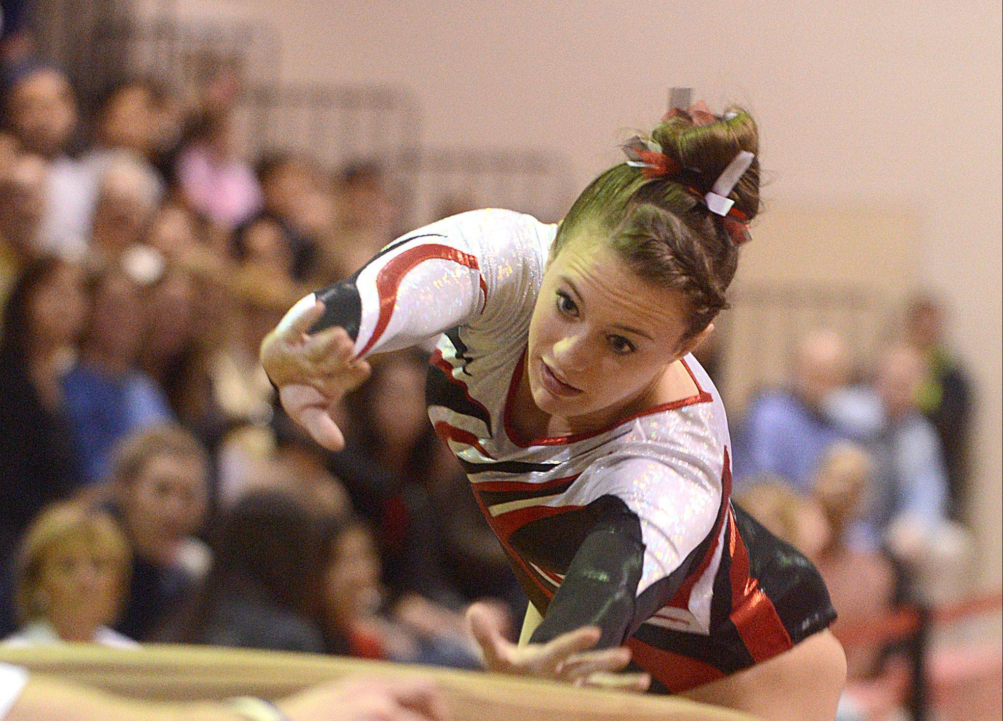 Barrington's Molly Blanke competes on vault in Monday's regional hosted by Barrington.