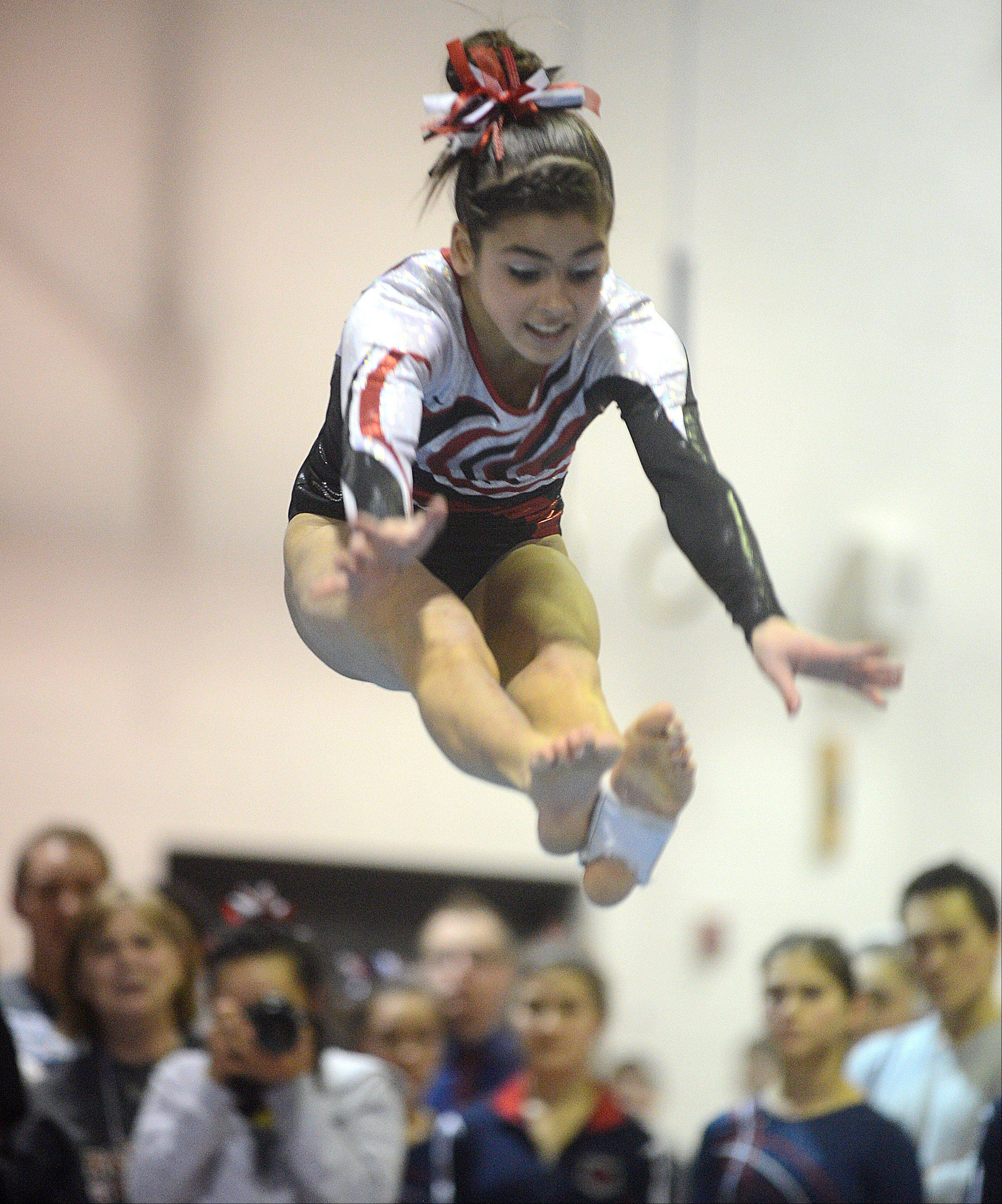 Barrington's Abby Hasanov soars during her floor exercise routine during Monday's regional hosted by Barrington.