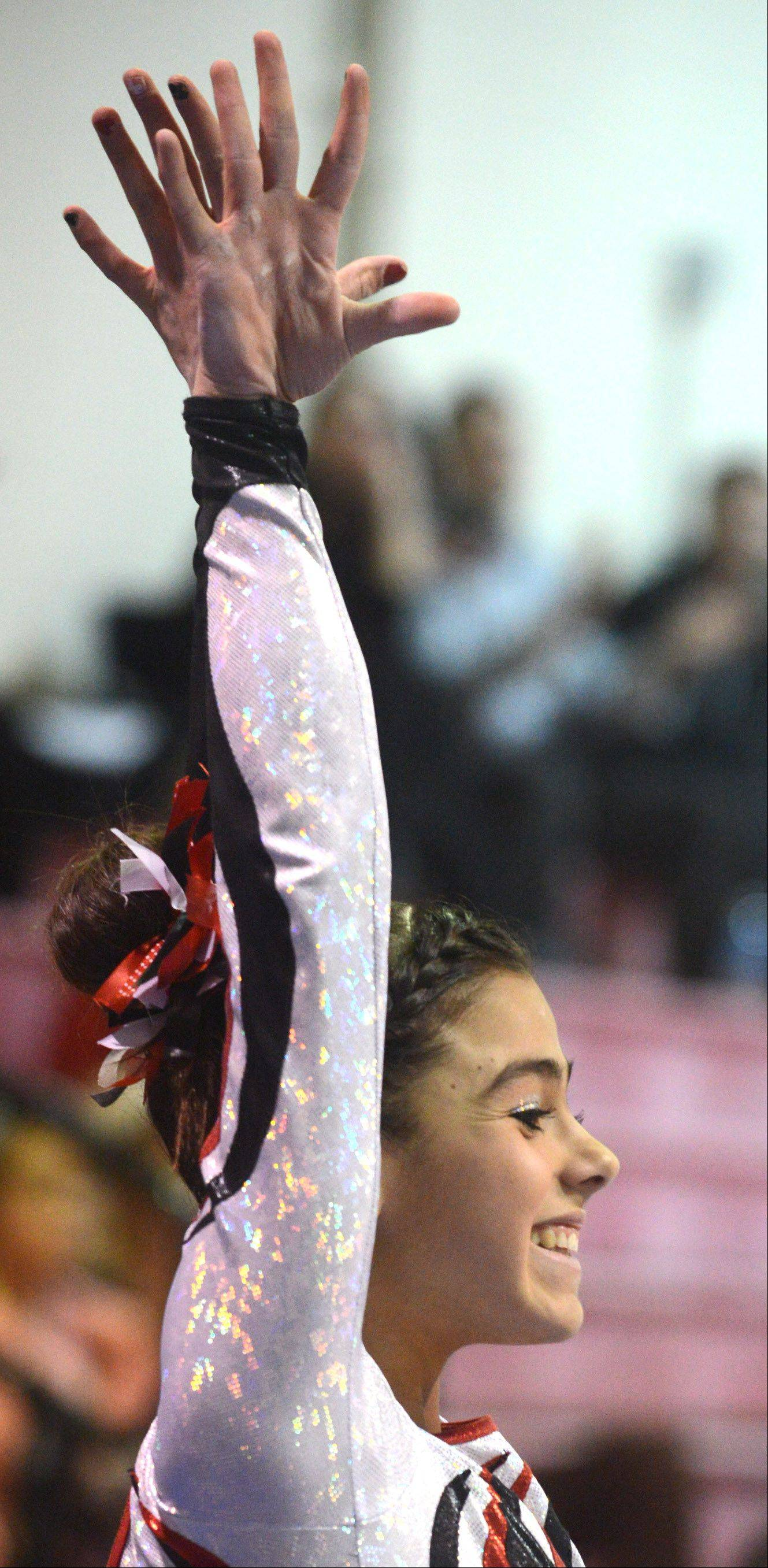 Barrington's Abby Hasanov acknowledges applause after a vault effort during Monday's regional hosted by Barrington.