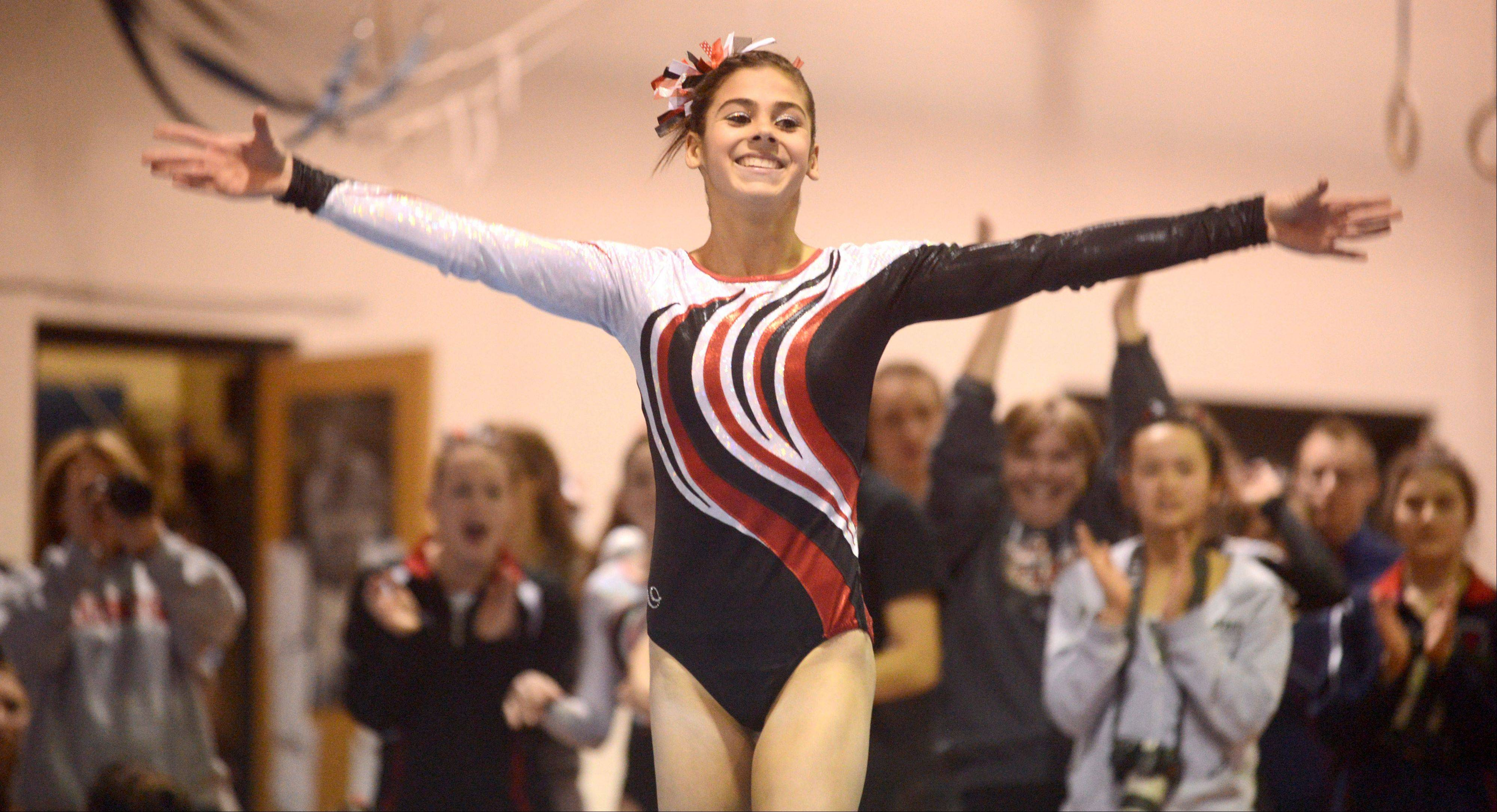 Barrington's Abby Hasanov completes her floor exercise routine during Monday's regional hosted by Barrington.