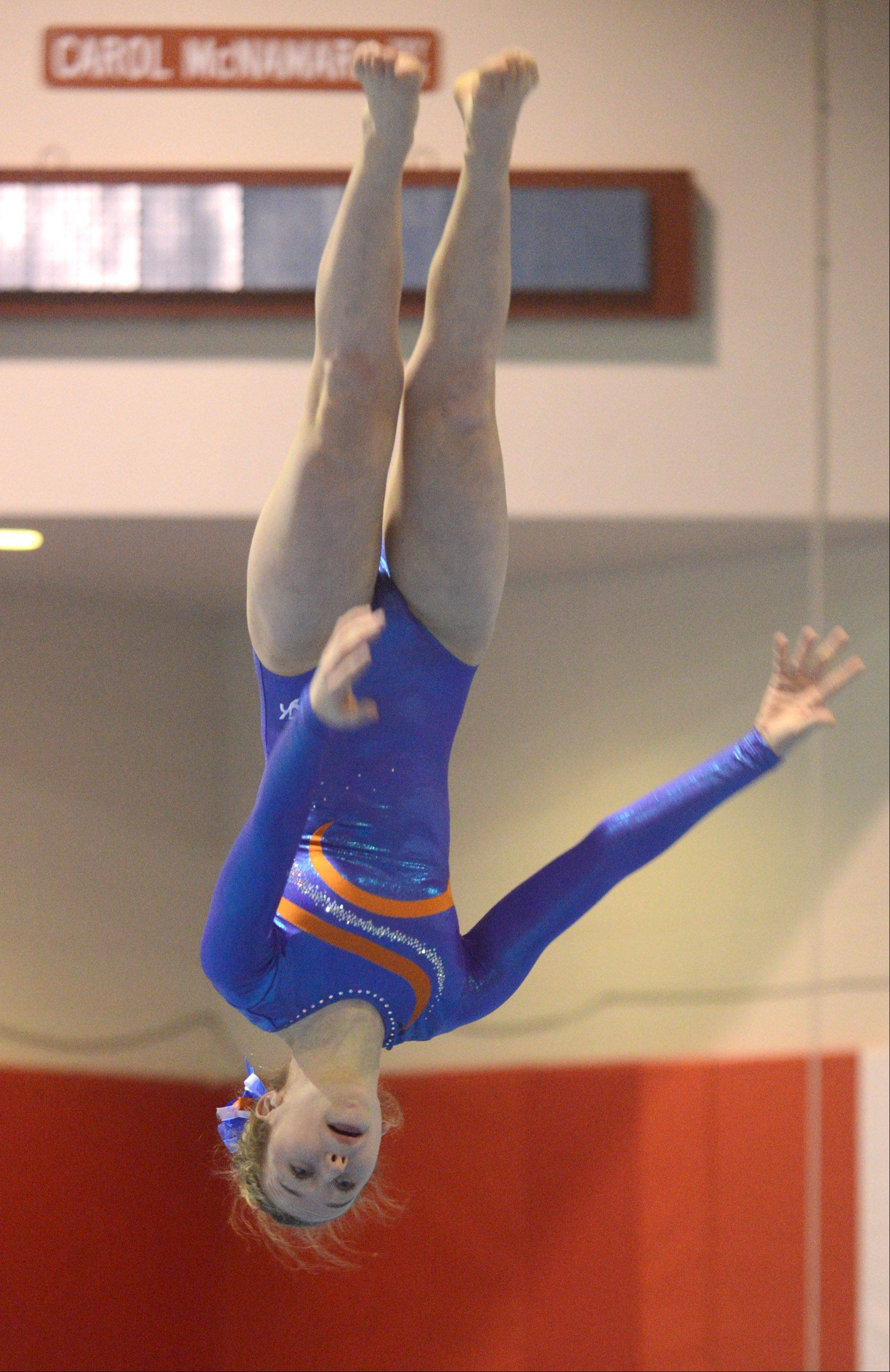 Hoffman Estates' Sidney Blanz-Enright flies through her floor exercise routine during Monday's regional hosted by Barrington.