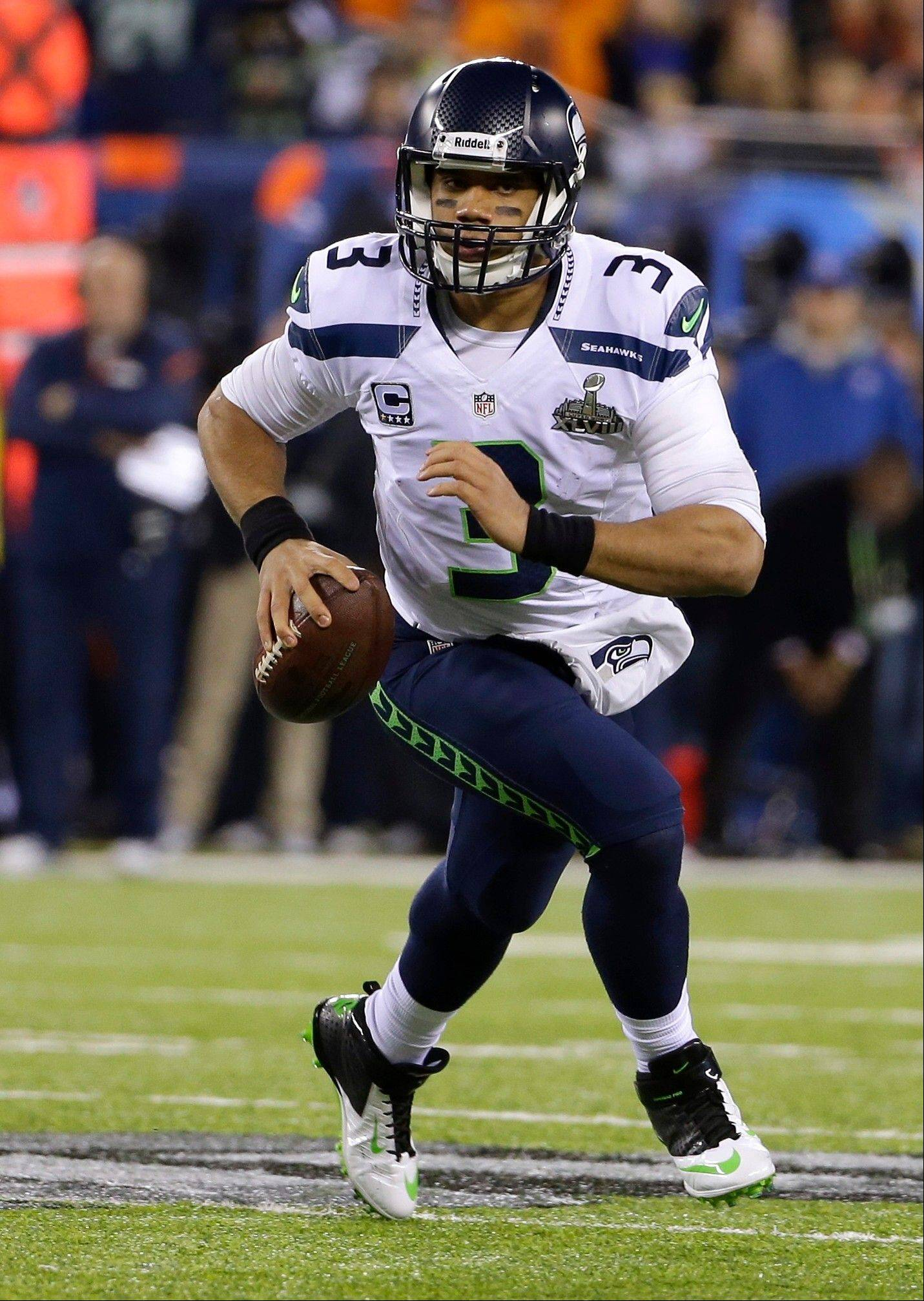 The brilliant performance of Seahawks quarterback Russell Wilson in Super Bowl XLVIII on Sunday is unquestionably the most overlooked aspect of the beating Seattle put on Denver, according to Barry Rozner, who points out: the scary part for the NFC is Seattle was the second-youngest Super Bowl-winning team ever and the Seahawks don't have to pay Wilson for two more years.