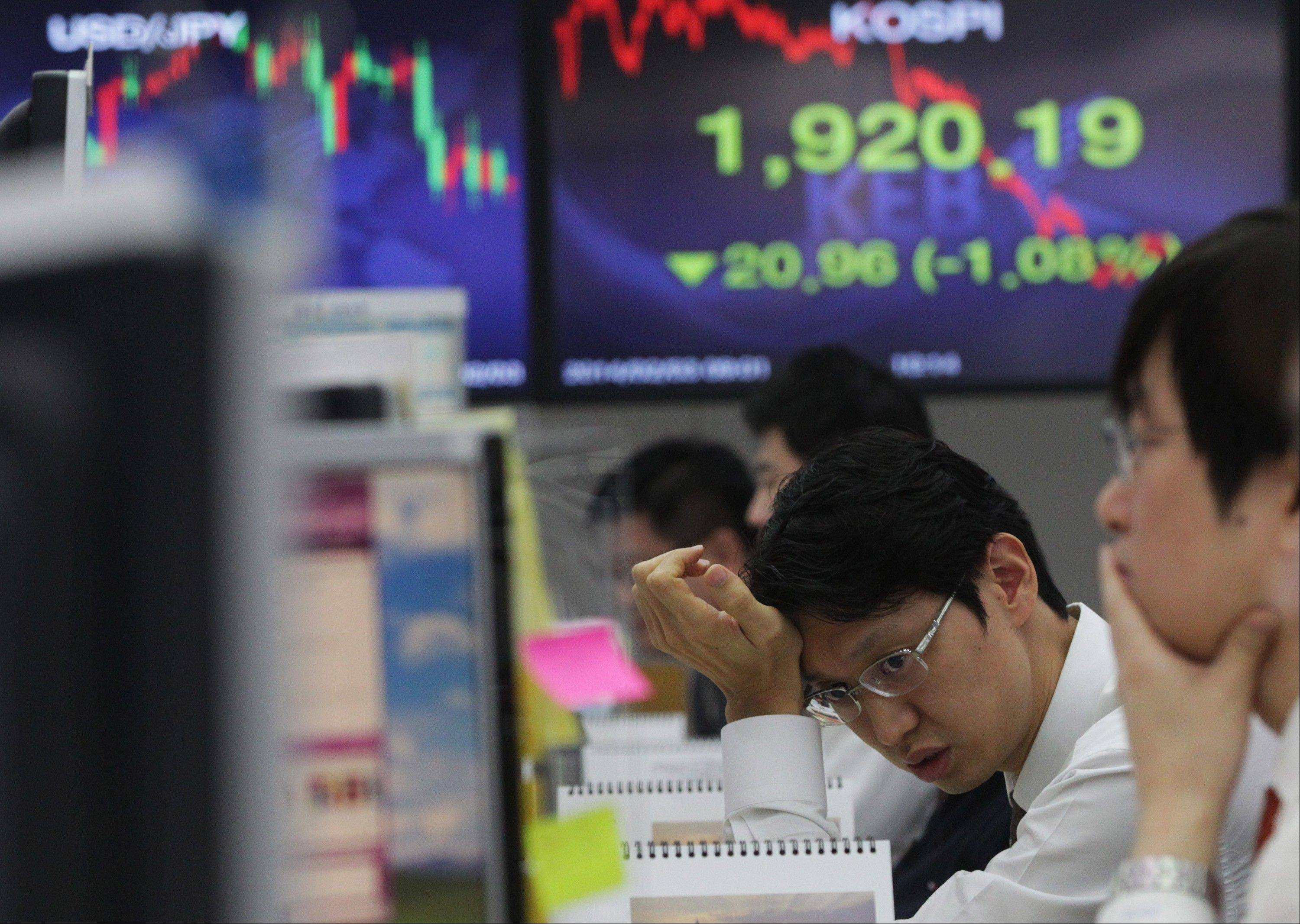 A currency trader works at the Korea Exchange Bank headquarters in Seoul, South Korea. Emerging market worries have helped drive U.S. stocks� disappointing performances so far this year.