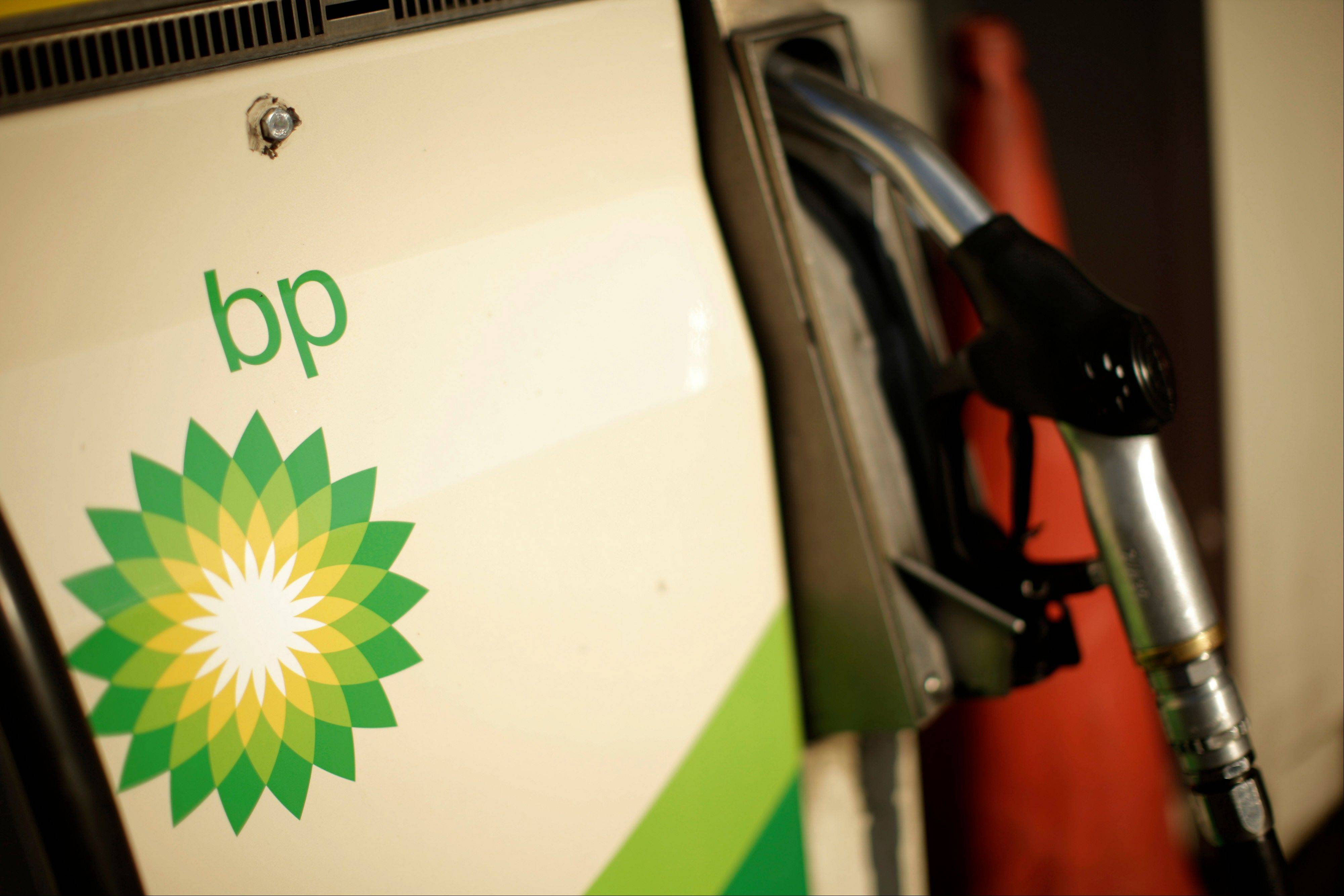 BP PLC's fourth-quarter profits fell 30 percent as the asset sales that it has pursued to compensate victims of the Gulf of Mexico oil disaster reduced production.
