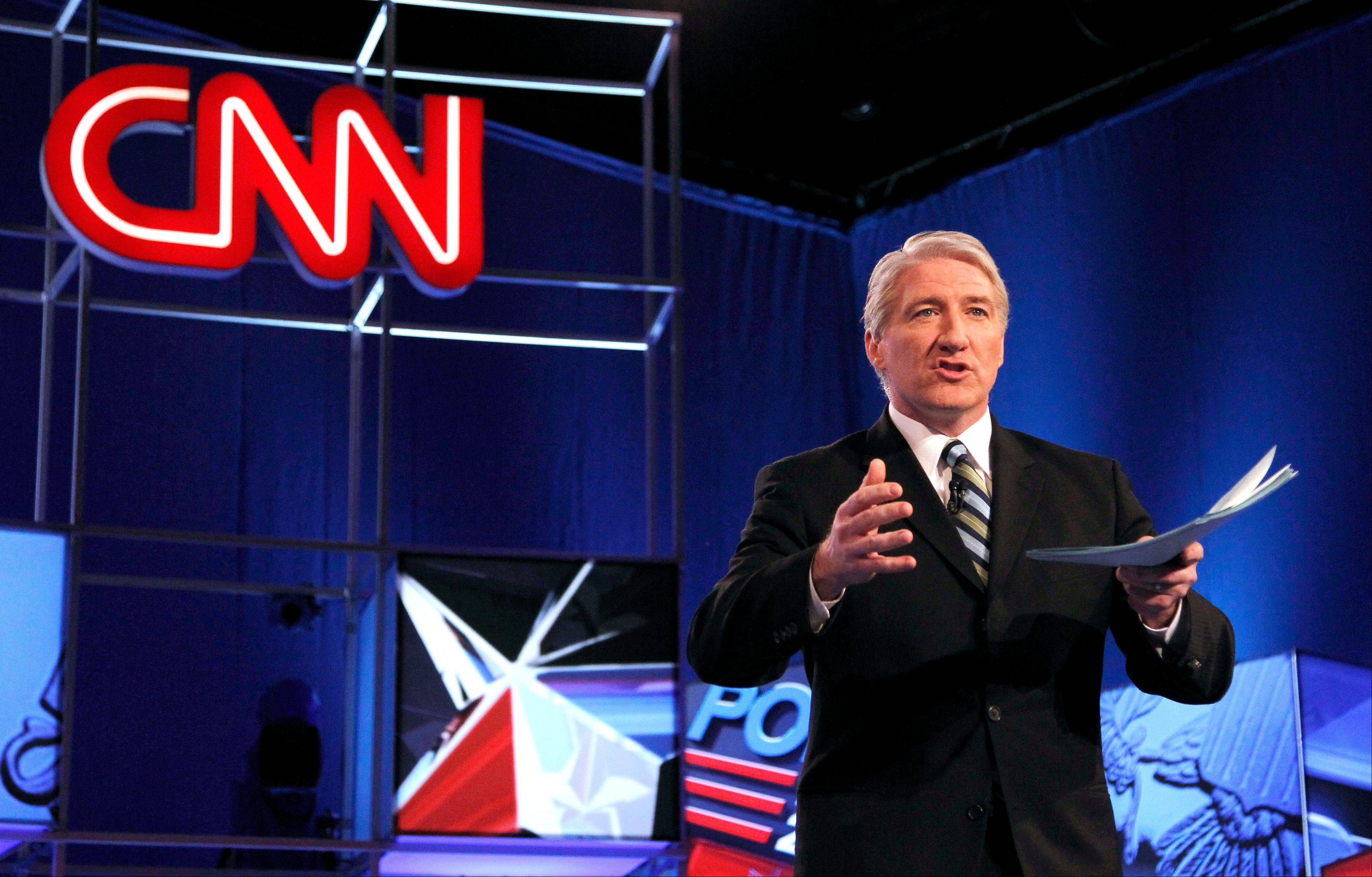 This Feb. 22, 2012 photo shows CNN's John King before the Republican presidential candidates debate in Mesa, Ariz. High-speed Internet services represent the fastest growing and most profitable line of business for cable companies. Last year, providing Internet access was 12 percent more profitable for Time Warner Cable than providing TV packages, despite taking in a third less revenue. Time Warner Cable has so far resisted Charter's overtures, but Charter has vowed to take the bid directly to shareholders if needed.