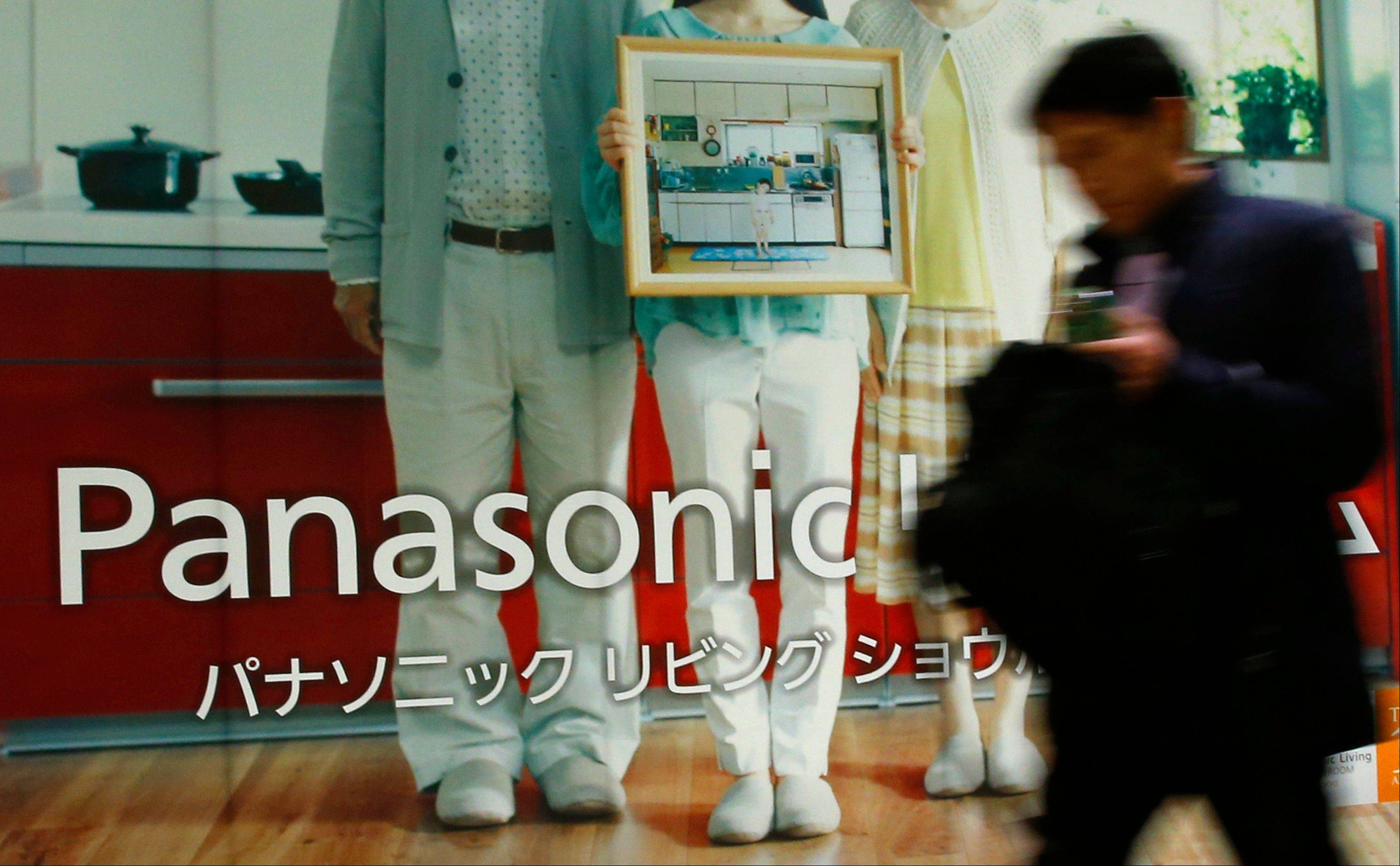 A man walks in front of a Panasonic showroom in Tokyo Tuesday.