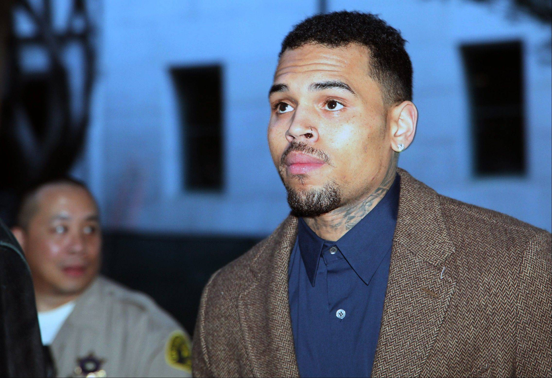 R&B singer Chris Brown arrives at a Los Angeles Superior Court for a probation review hearing on Monday. The judge rejected a prosecutor's request during the hearing to have Brown sent to jail over the misdemeanor assault case filed last year in Washington, D.C.