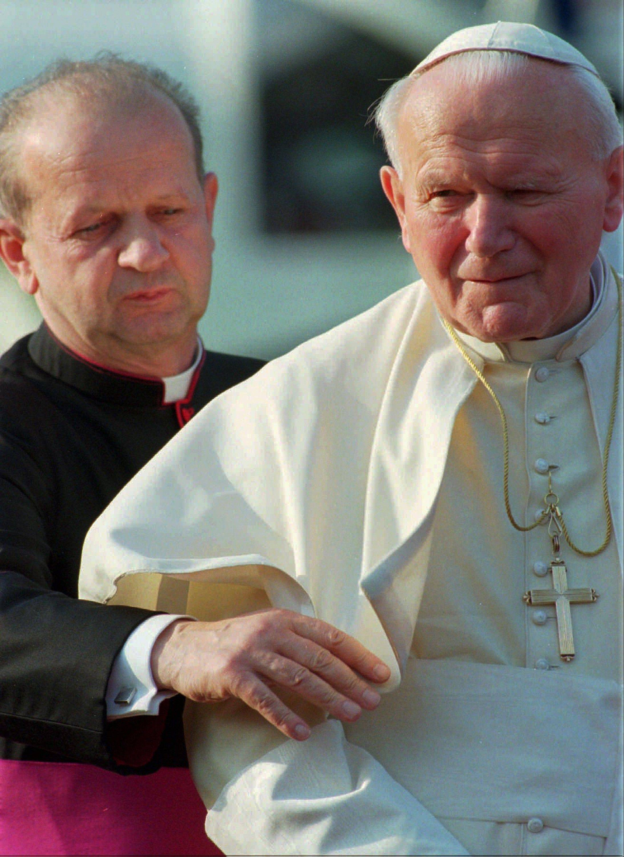 Poles are divided between praise and condemnation of Pope John Paul II�s personal secretary Stanislaw Dziwisz over publishing the beloved pontiff�s personal notes against his last will and testament.