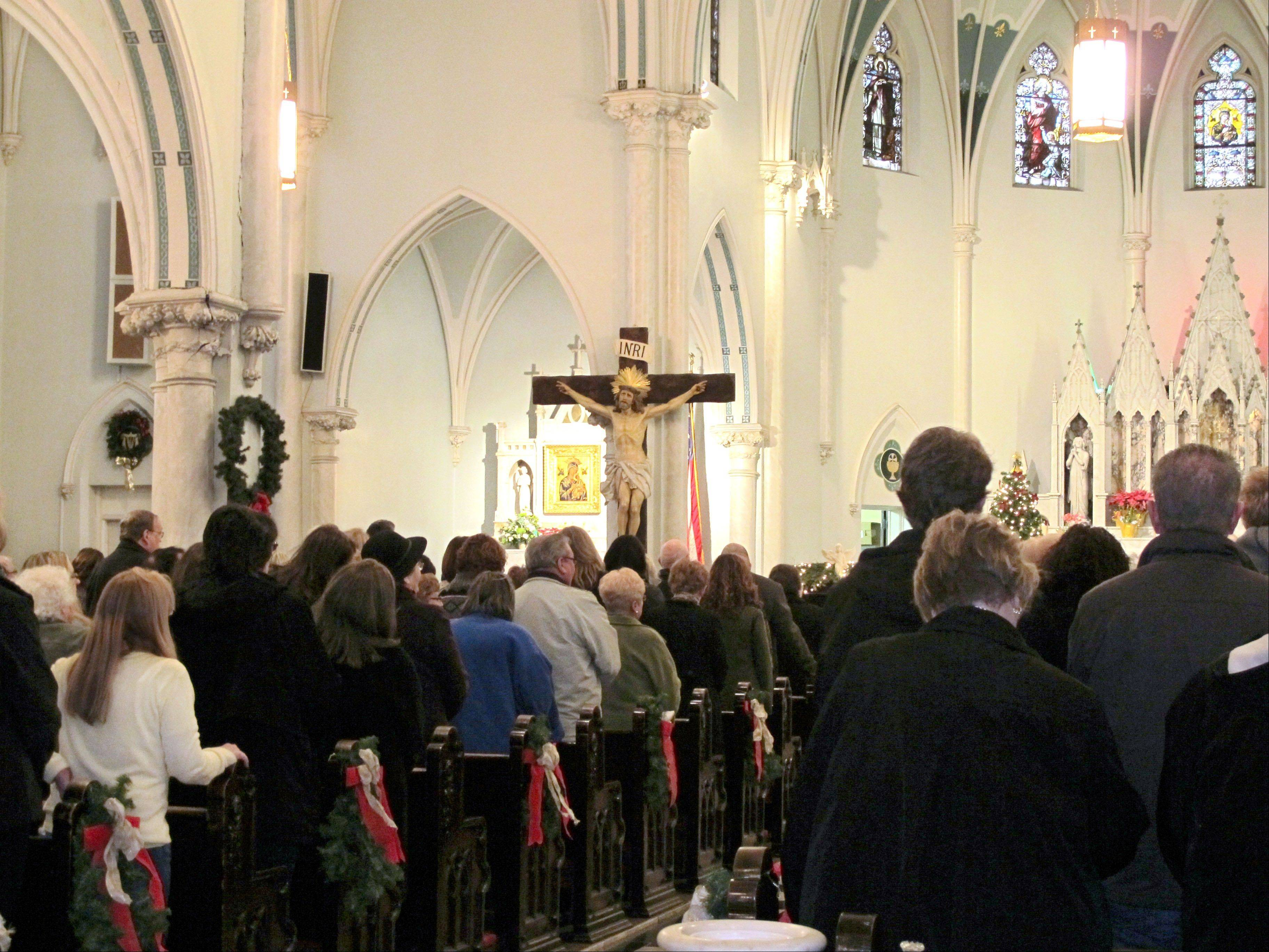 People gathered for mass inside Our Lady of Perpetual Help Church in Buffalo, N.Y., during a Mass mob. Borrowed from the idea of flash mobs, Mass mobs encourage crowds to attend Mass at a specified church on a certain day to fill pews, lift spirits and help financially some of the city's oldest but often sparsely attended churches.