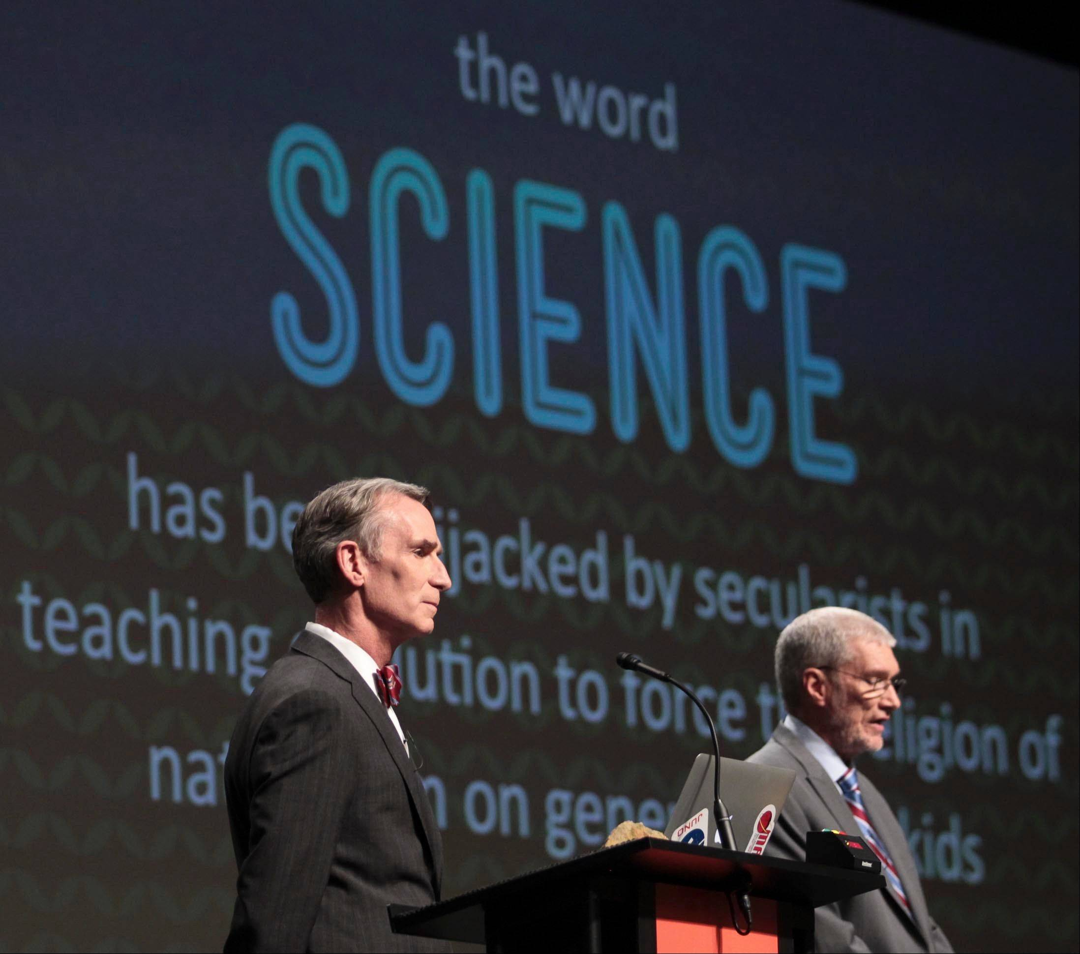 "Creation Museum head Ken Ham, right, speaks Tuesday during a debate on evolution with TV's ""Science Guy"" Bill Nye, at the Creation Museum in Petersburg, Ky."