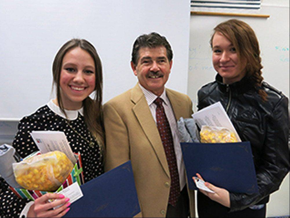 "COURTESY COOK COUNTY CLERK Cook County Clerk David Orr congratulates Maine East High School students Andrea Garneata and Veronica Malesinski, the winners of a ""Voting at 17"" video contest."