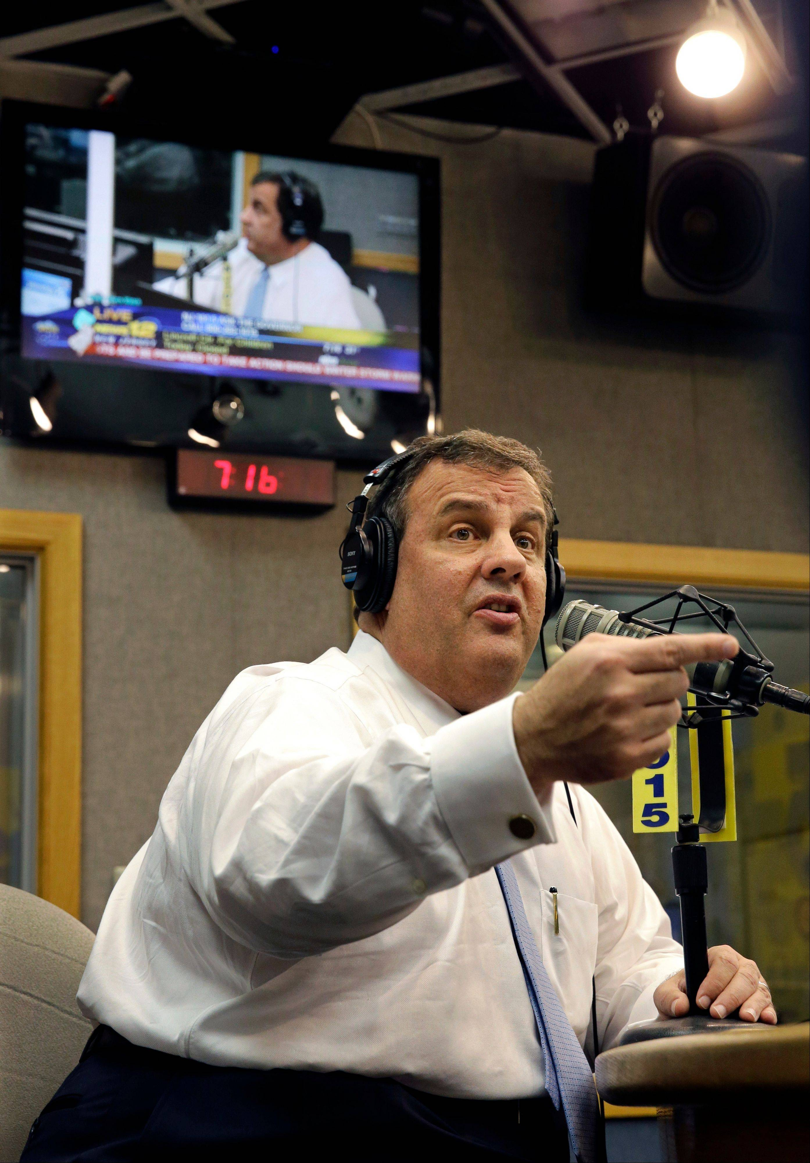New Jersey Gov. Chris Christie sits in a studio during his radio program, �Ask the Governor� broadcast on NJ 101.5, Monday, Feb. 3, 2014, in Ewing, N.J. During the program, Christie took questions from callers for the first time in more than three weeks as his campaign looked for a way to pay for lawyers as a political payback scandal continues.