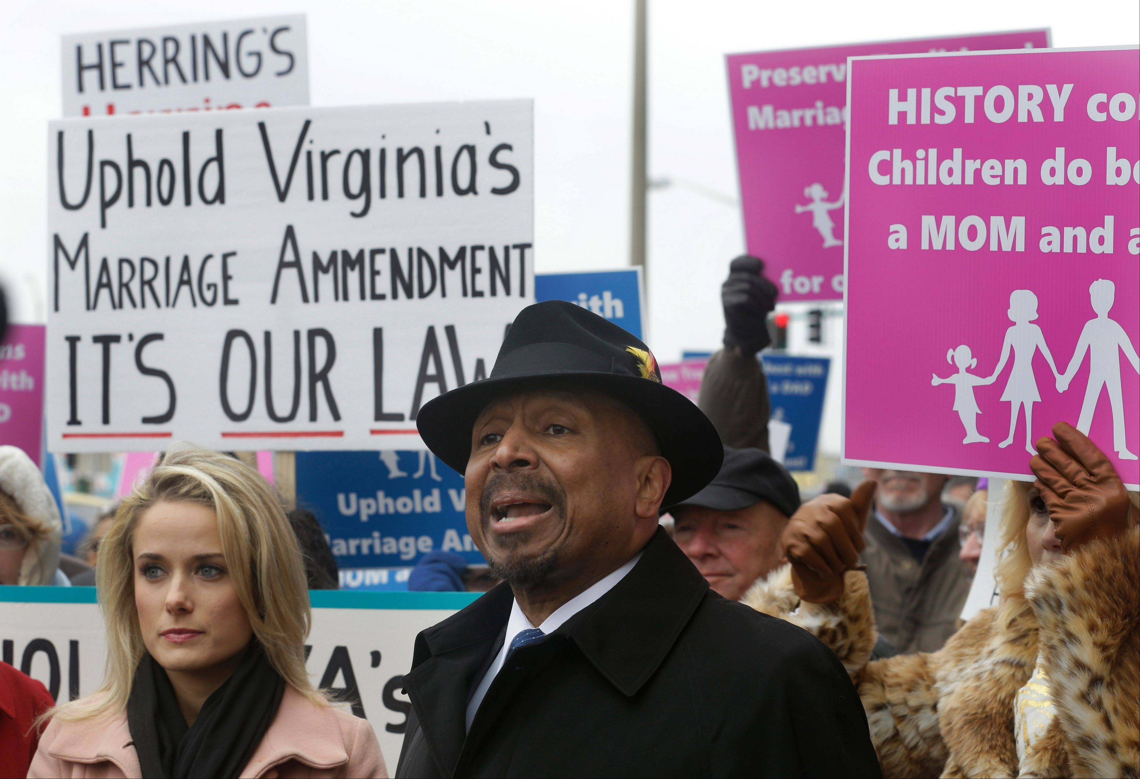 Former Republican lieutenant governor candidate E.W. Jackson, front center, speaks in favor of the law banning same-sex marriage. A federal judge will hear arguments Tuesday on whether Virginia�s ban on gay marriage is unconstitutional.