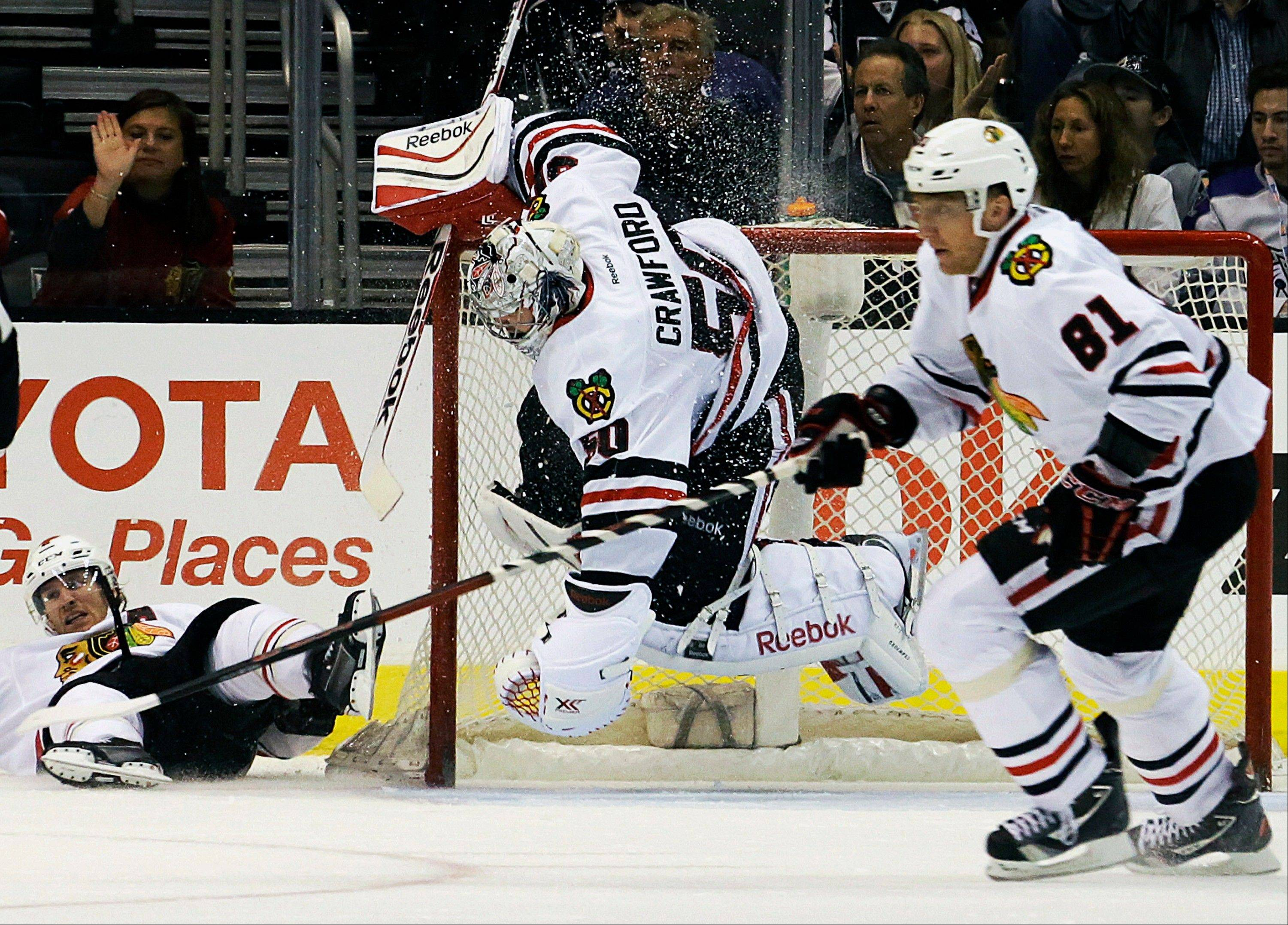 Blackhawks goalie Corey Crawford goes airborne as he and right winger Marian Hossa block the goal against the Kings in the third period of Monday night's 5-3 Hawks victory.