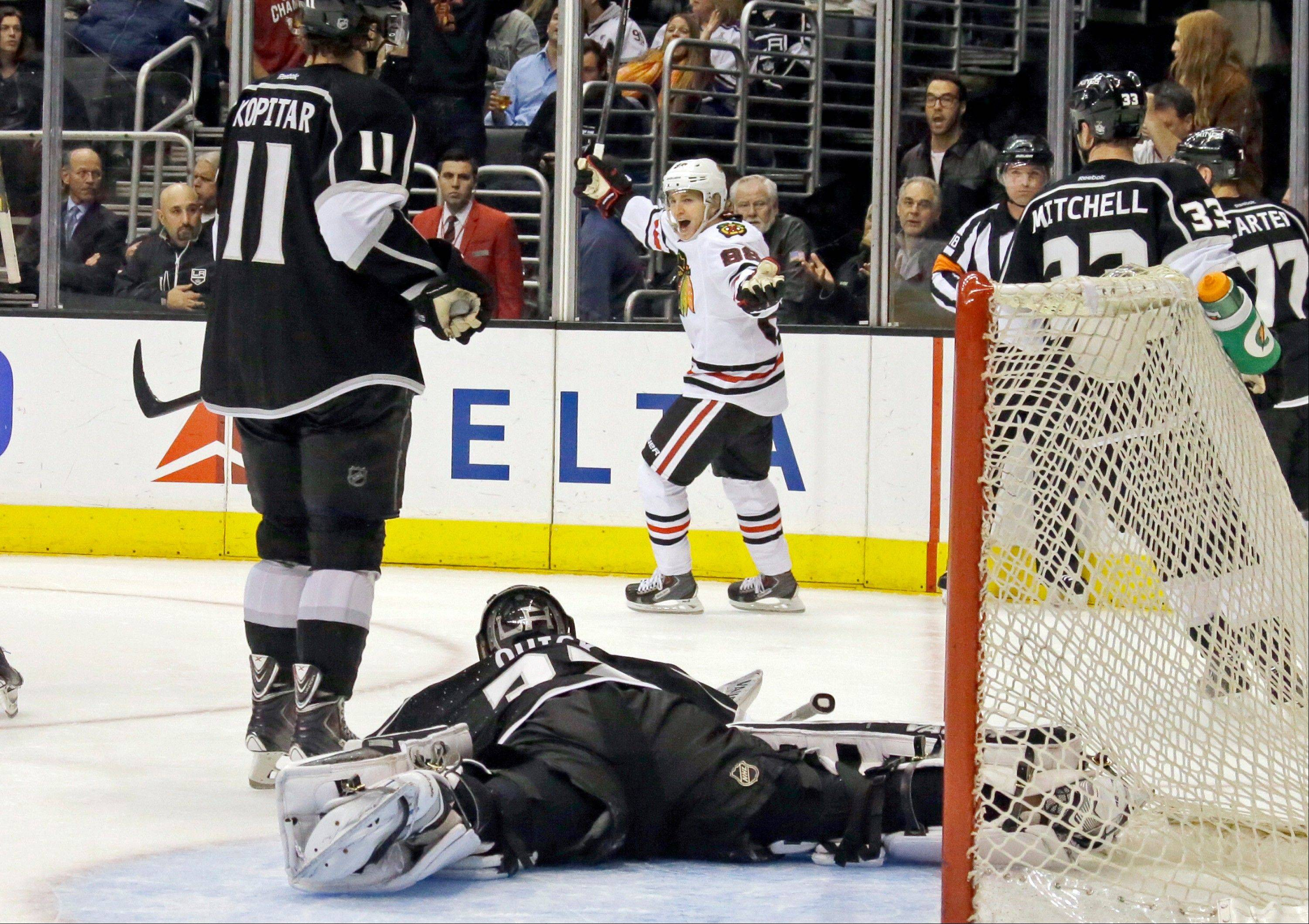 Blackhawks right winger Patrick Kane (88) scored twice against Los Angeles Kings goalie Jonathan Quick (32) on Monday. After each goal, Kane raised an arm and pointed to the heavens to honor his grandfather, who had passed away.