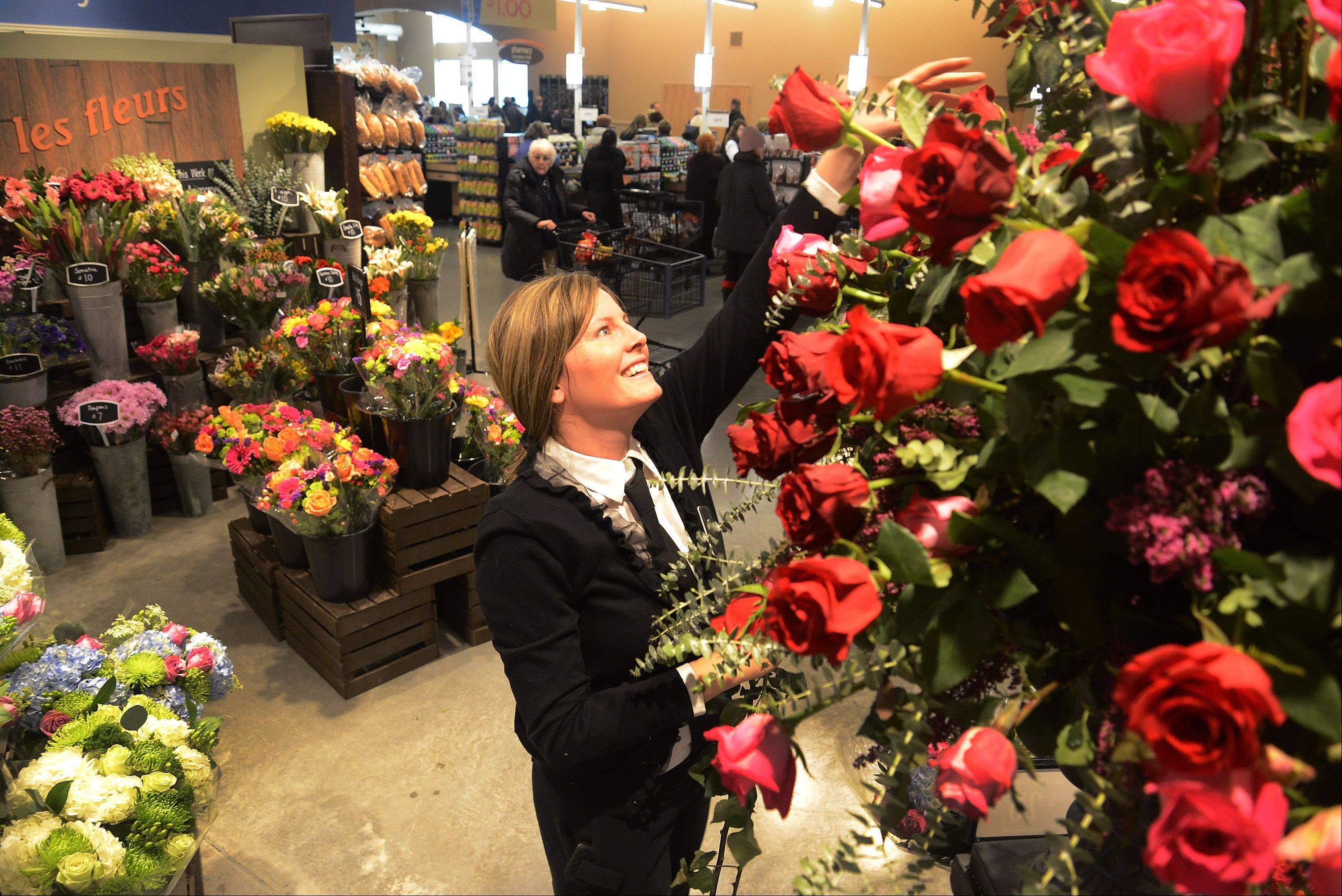 Rebecca Eckblad freshens up the roses in the floral department at the new Lake Zurich Mariano's grocery store that opened Tuesday.