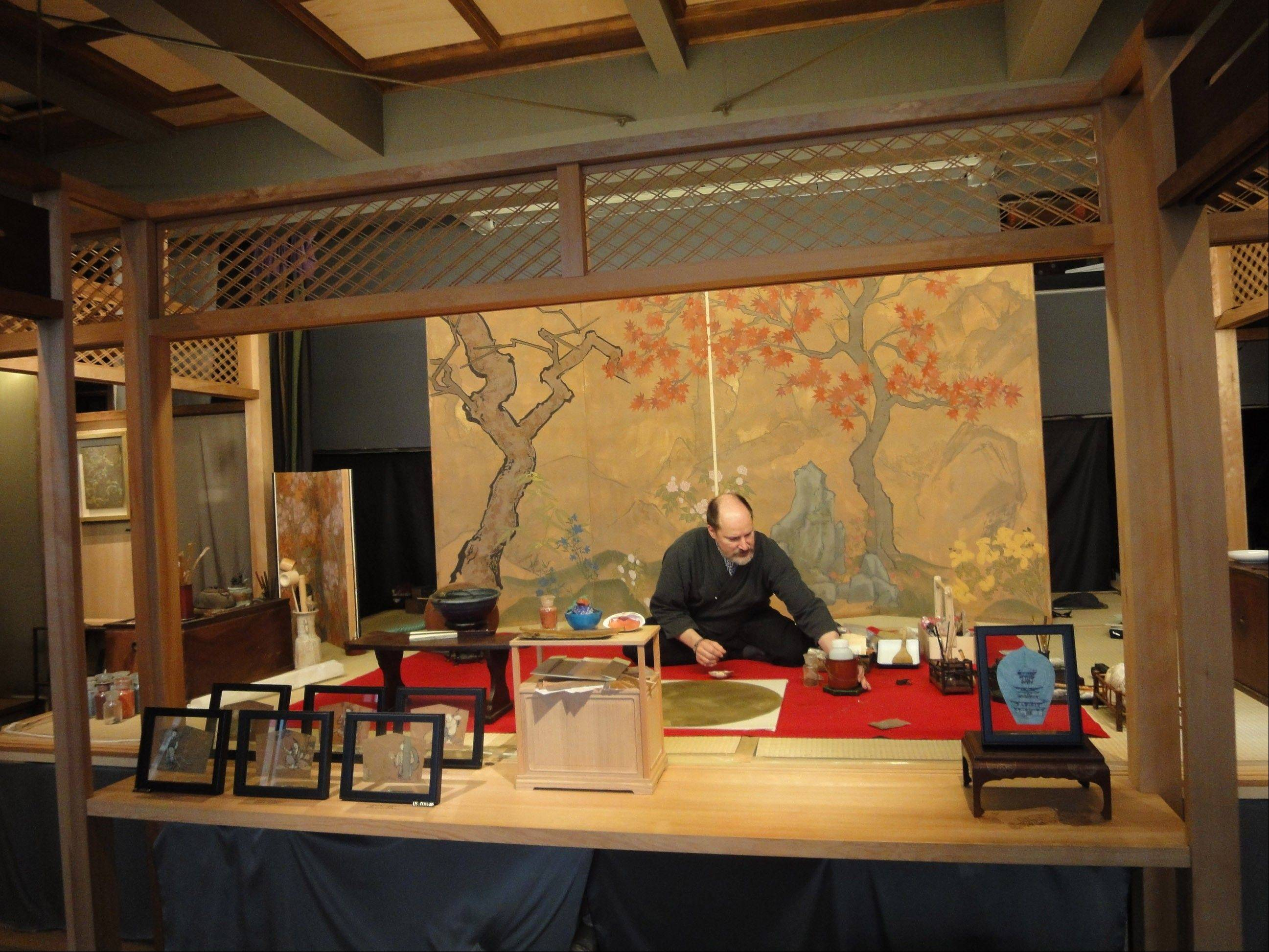 Artist Allan West works in his studio in the Yanaka neighborhood of Tokyo. Only nine stores remain in Japan that sell the traditional pigments West paints with, four of which are in Yanaka.