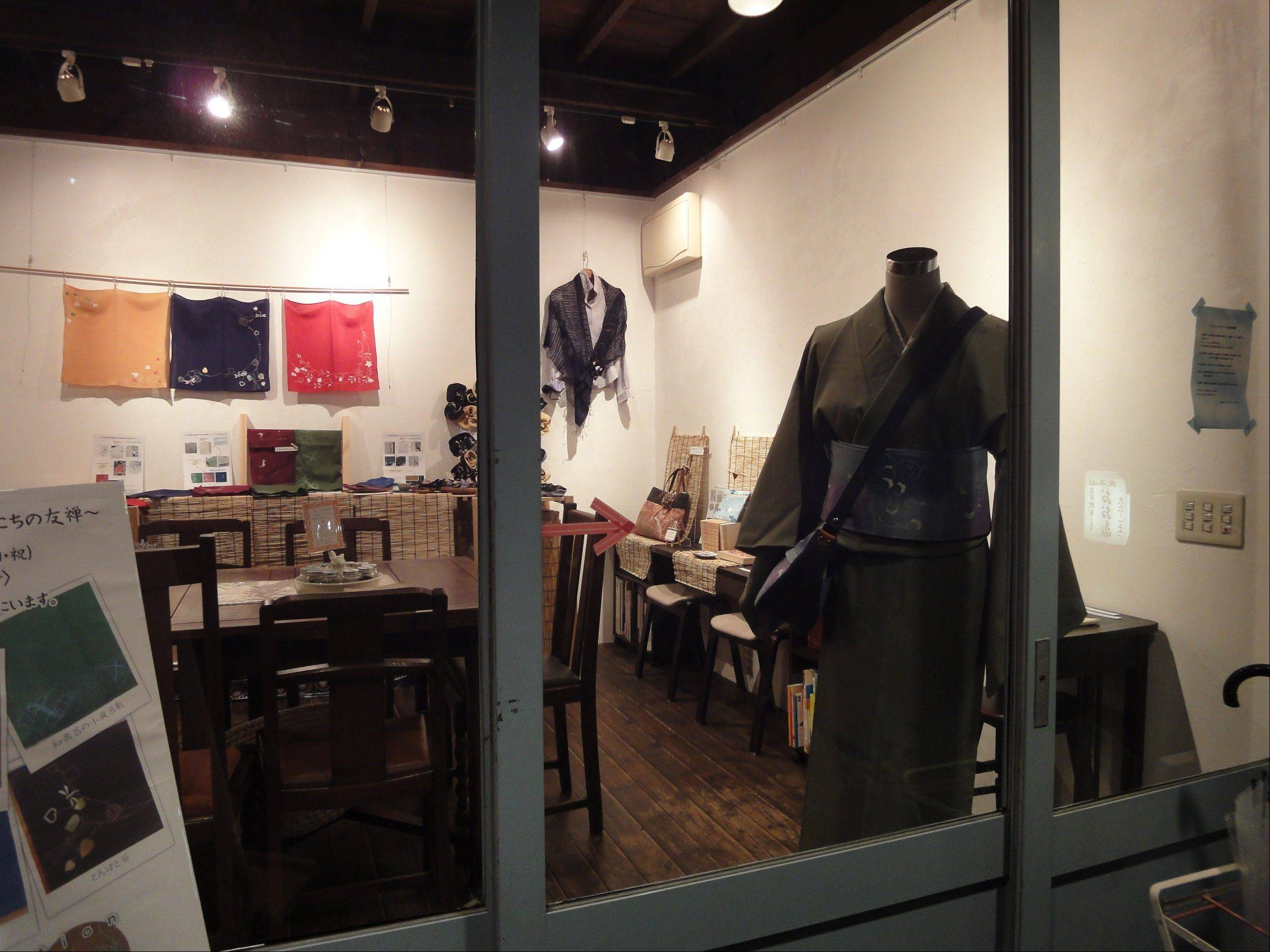 A handicrafts shop in Yanaka offers modern accessories like handbags made with traditional Japanese fabrics.