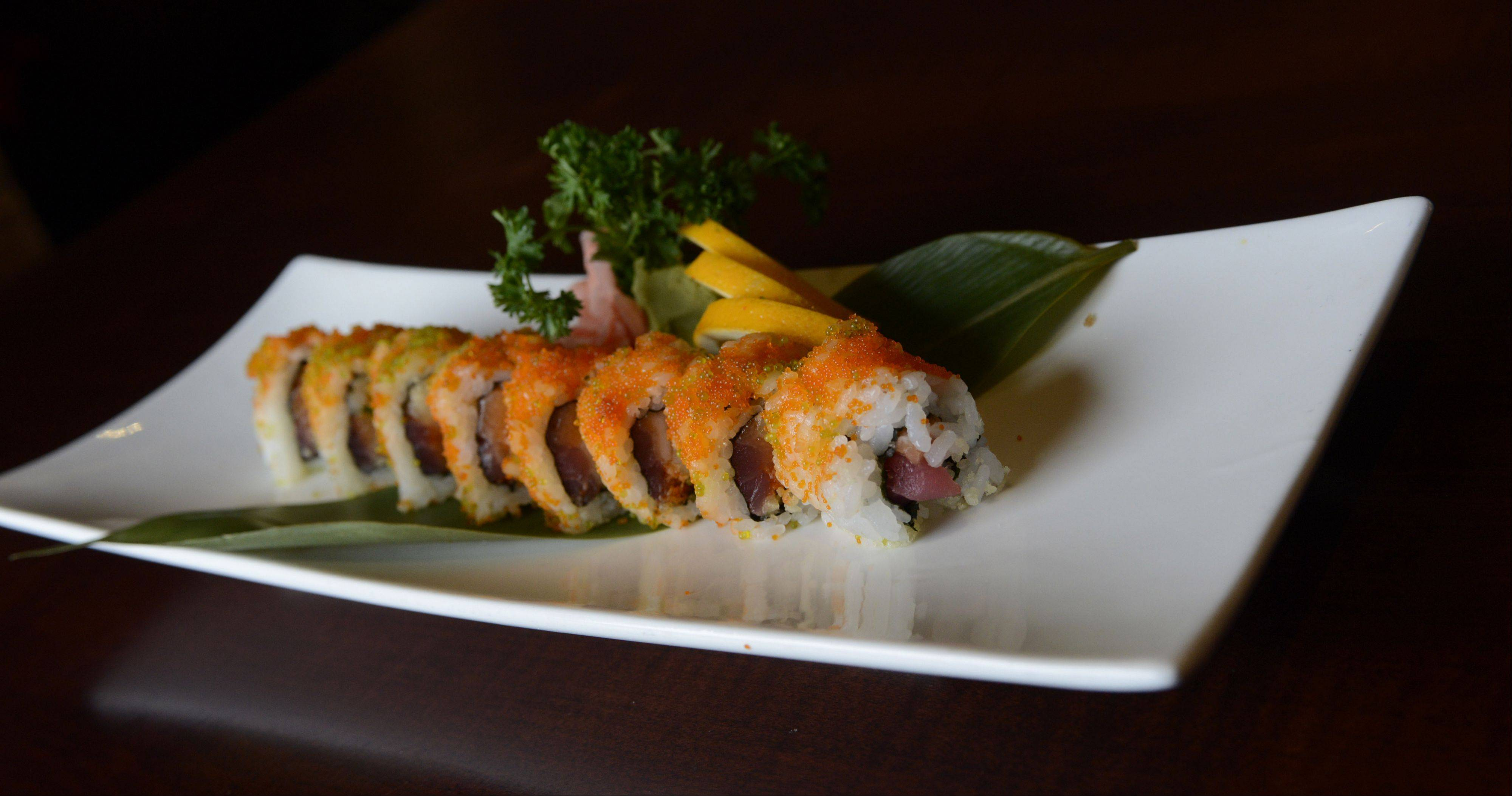 Wok'n Fire's Fantasy roll features tuna, red snapper, Sriracha sauce, scallion, tempura flakes and a sprinkling of orange-colored flying fish roe.