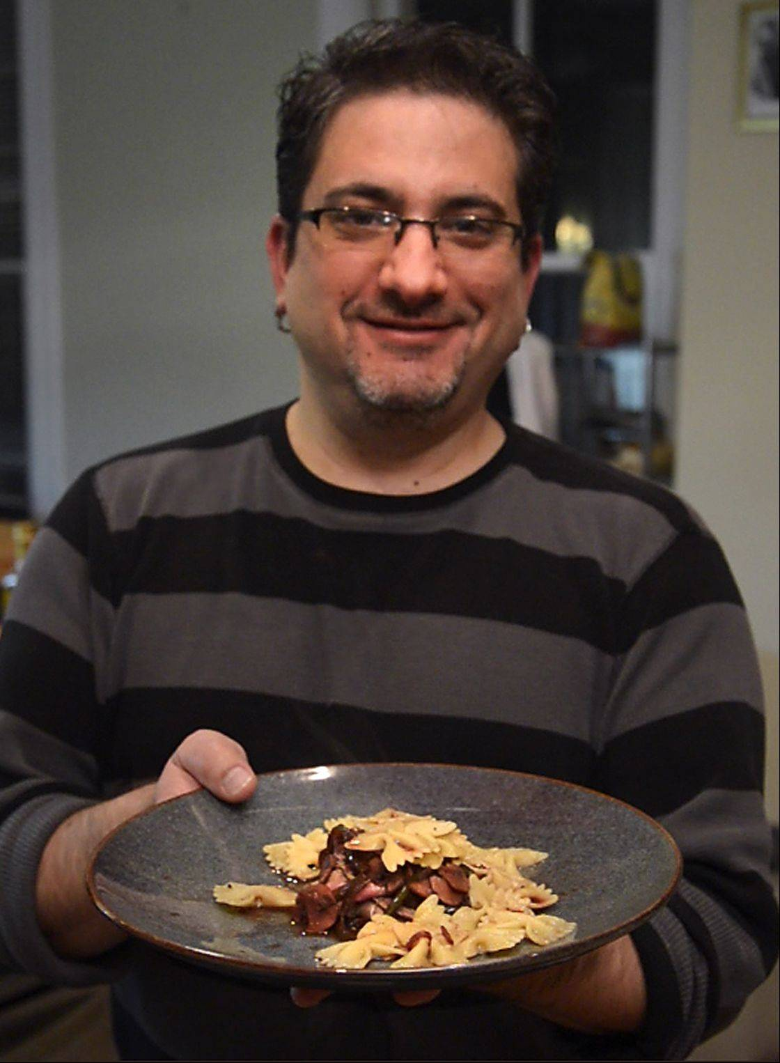Tony Aiello of Elgin focuses his creative culinary juices on sauces, like the burgundy and balsamic reduction, at right, he makes for steak and pasta.