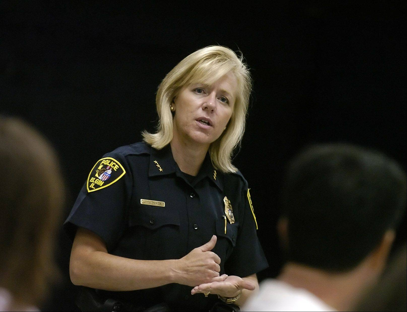 Former Elgin Police Chief Lisa Womack has been placed on leave from the police department in Lakeland, Fla., where she is schedule to resign as chief on May 1.