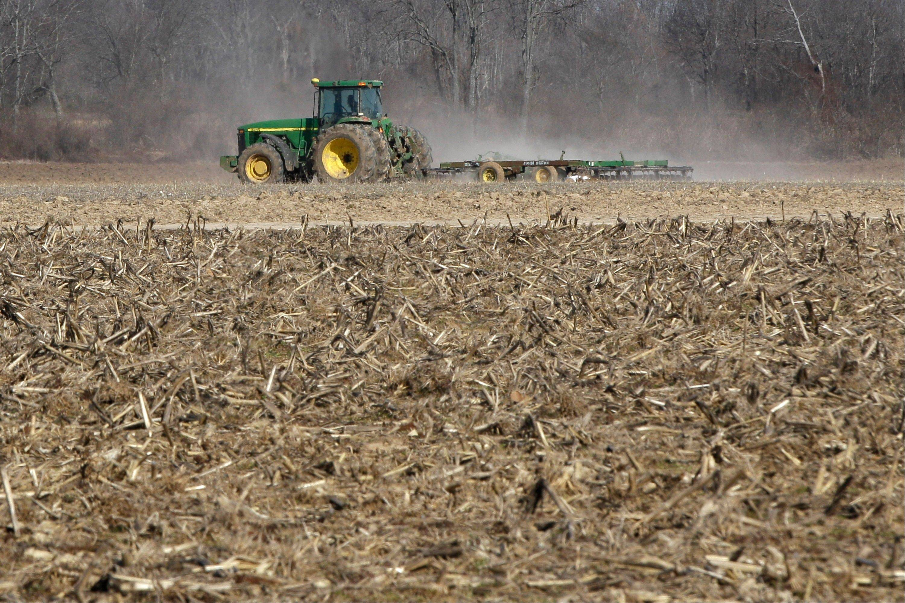 A farmer takes advantage of dry weather to till a field in preparation for spring planting near England, Ark., last month. Congress has given its final approval to a sweeping five-year farm bill that provides food for the needy and subsidies for farmers.
