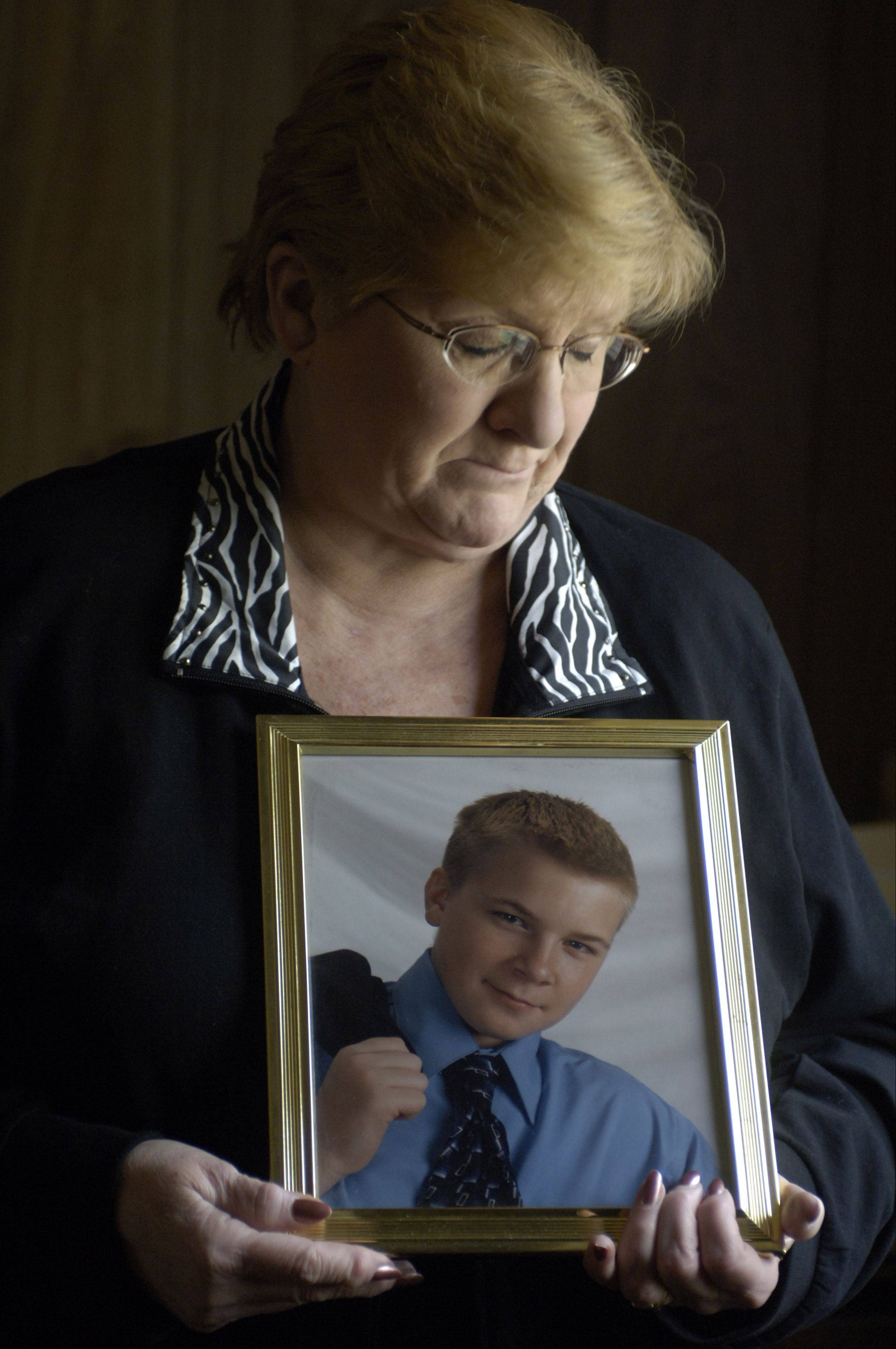 Nanci Koschman of Mount Prospect holds a photo of her son, David, who died after Richard Vanecko hit him during an altercation outside a Chicago bar.