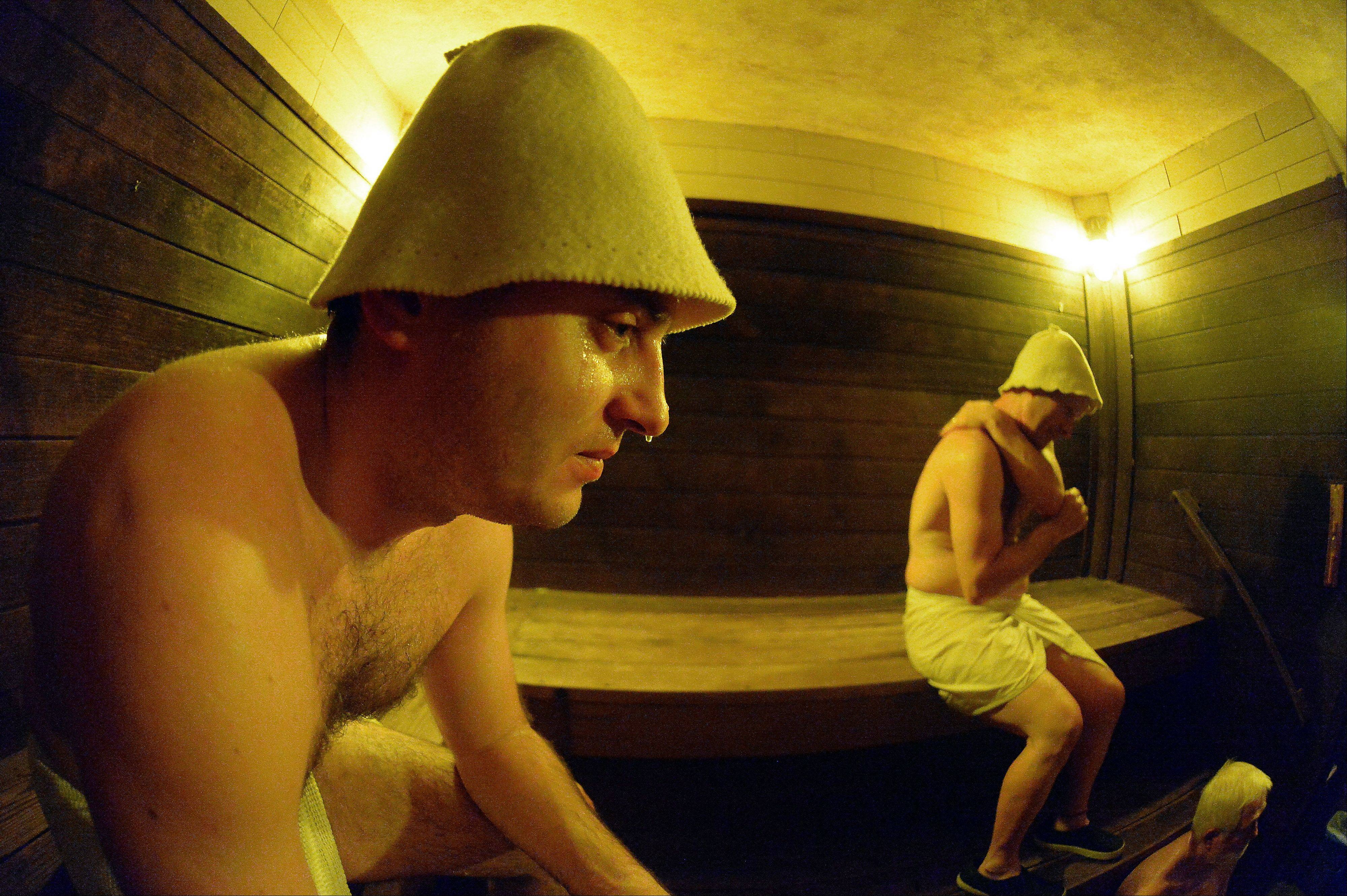 With sweat dripping off his nose, Igor Mikhno, 32, of Wheeling takes in the 210-degree heat of Chicago's Sweatlodge old-world sauna.