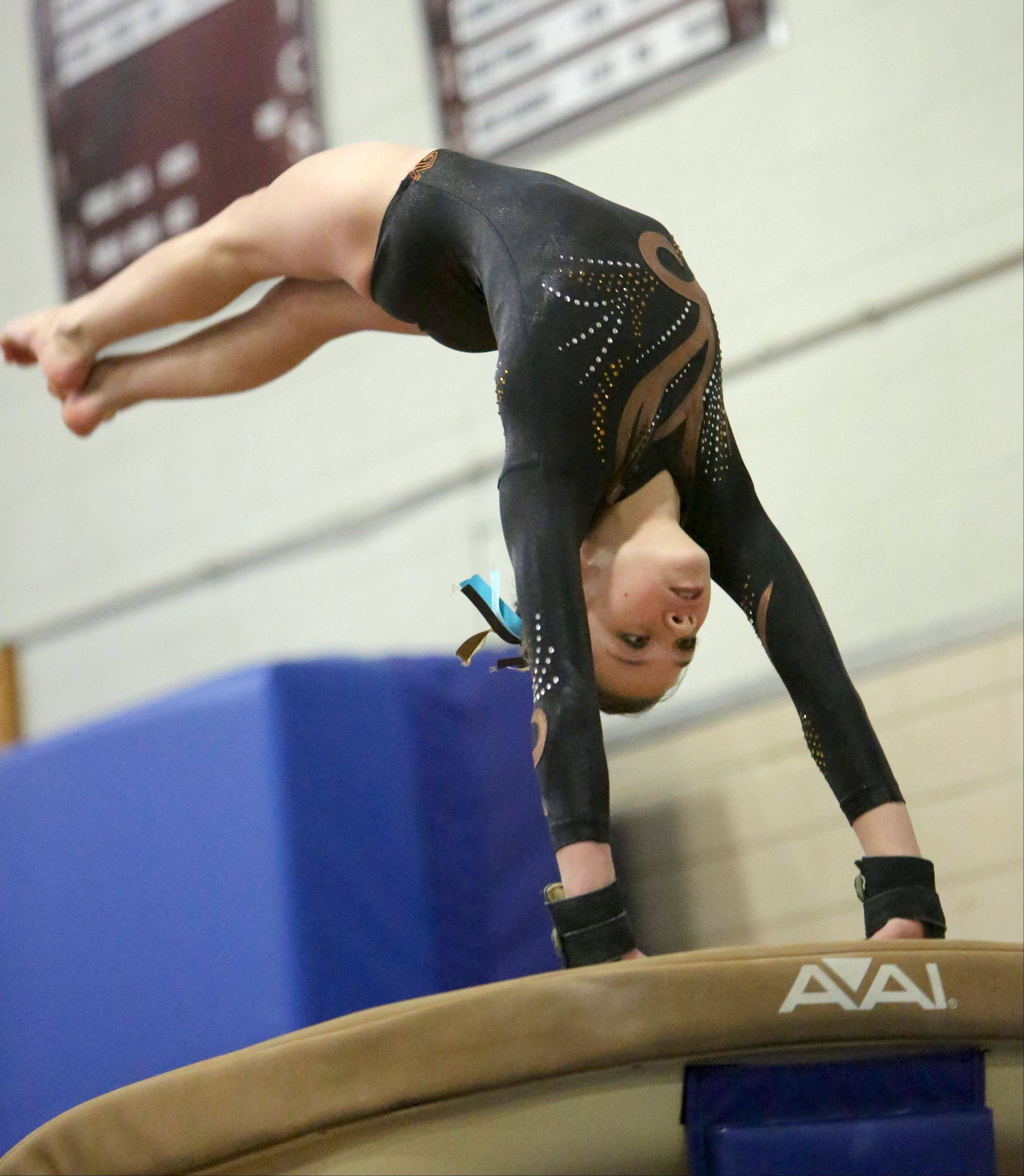 Carmel's Alyssa Legerreta competes on the vault during Tuesday's regional meet at Deerfield.