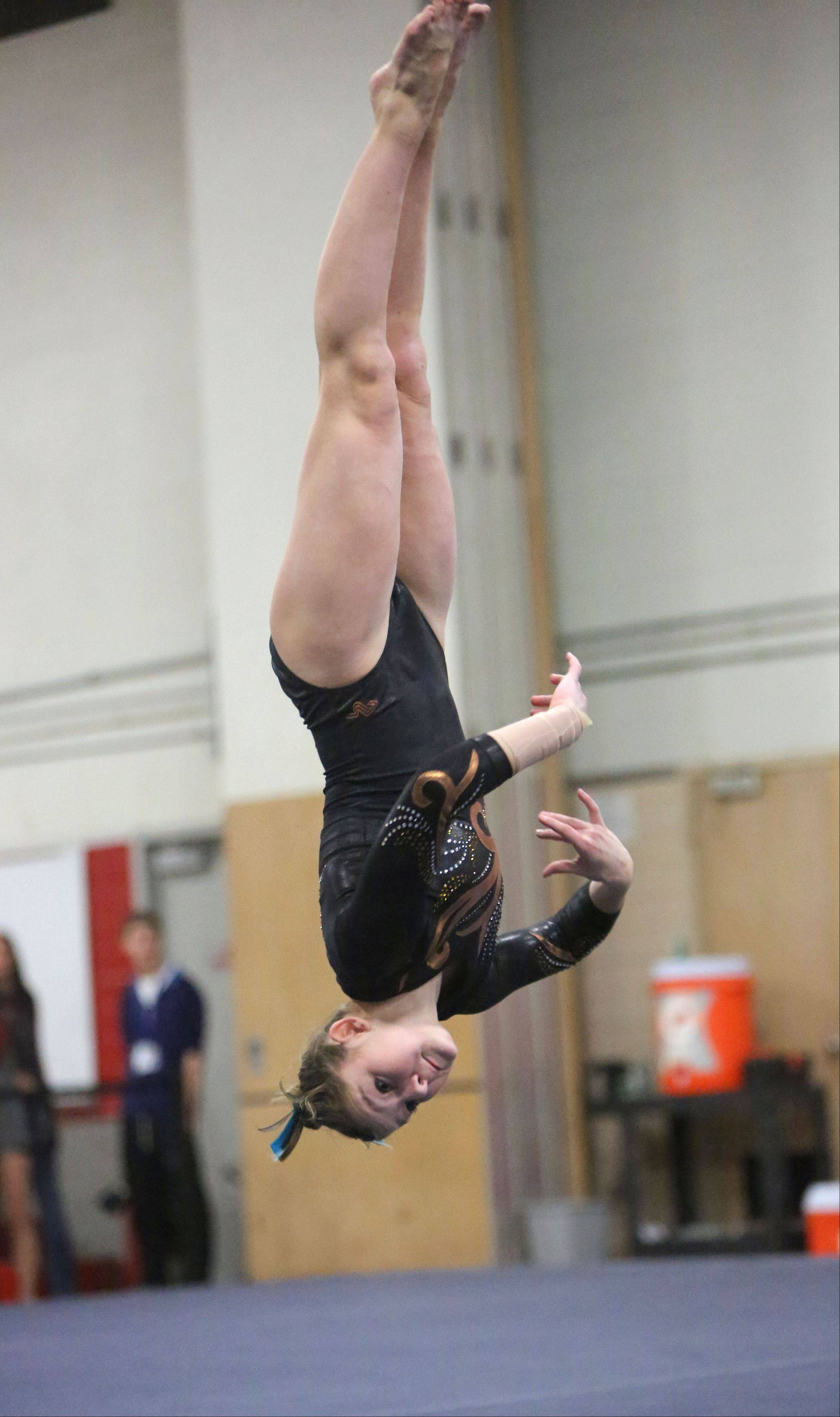 Carmel's Madison Graff competes on the floor exercise during Tuesday's regional meet at Deerfield.