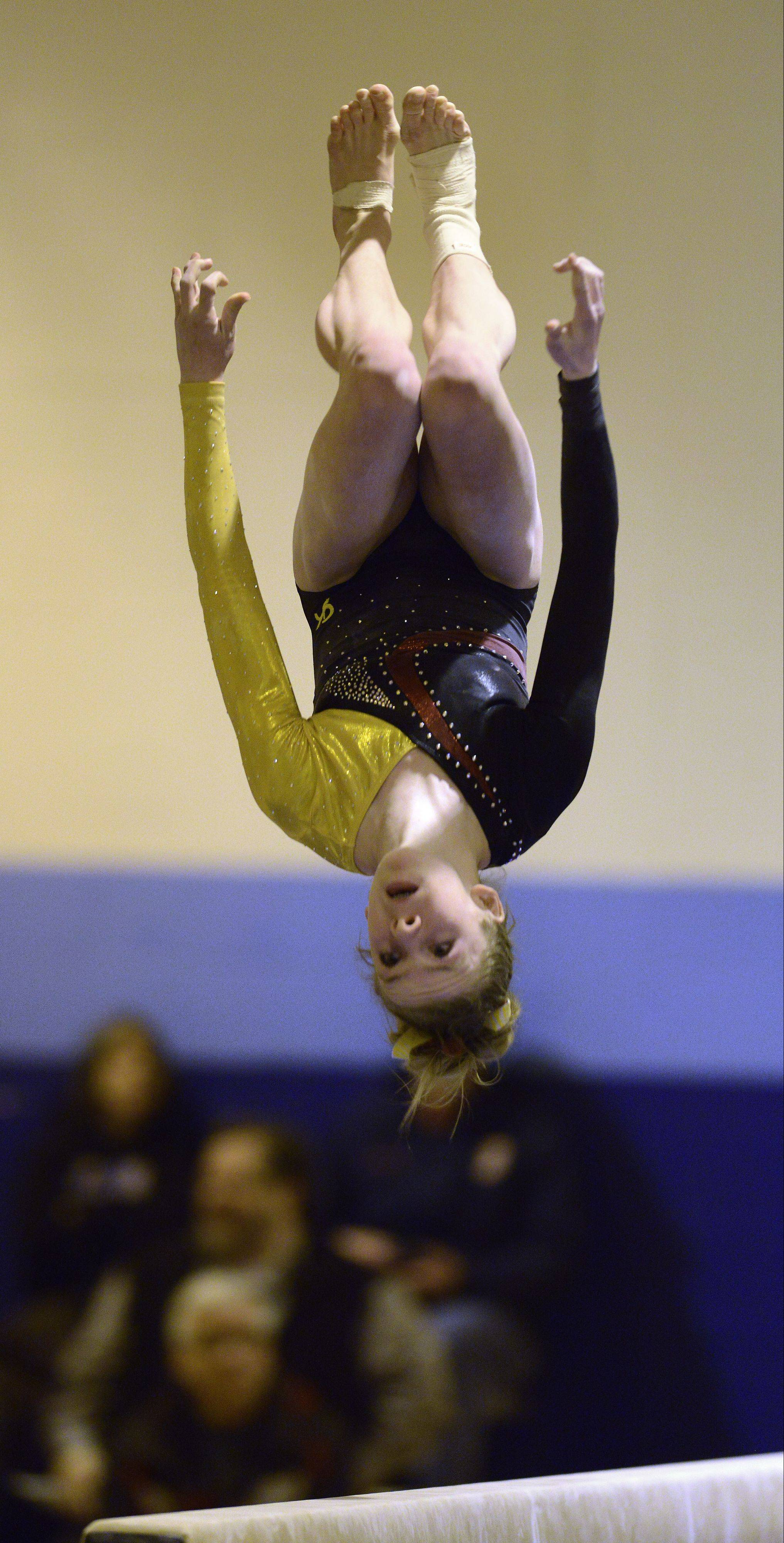 Schaumburg's Alyssa Kiszka competes on the balance beam during Tuesday's regional meet at Prospect.