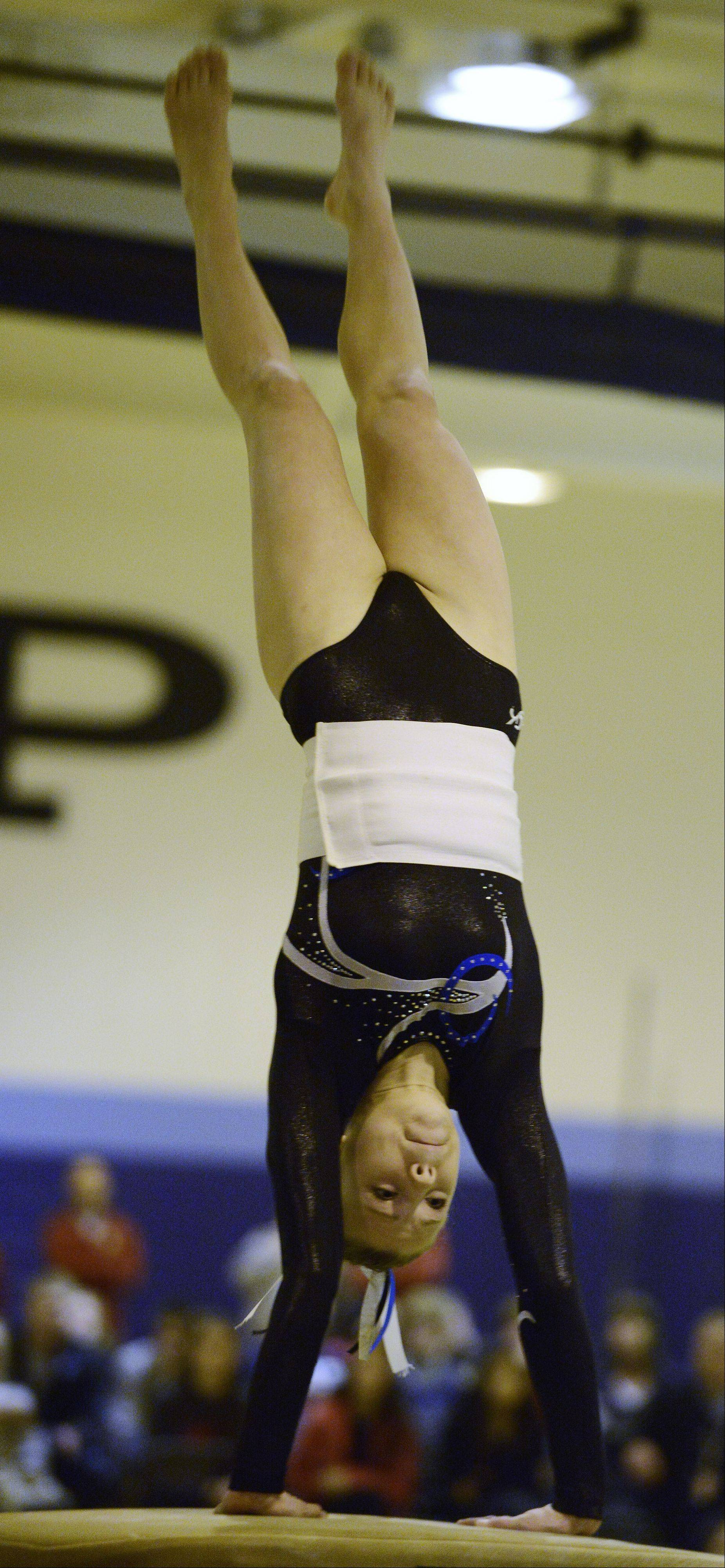 Prospect's Olivia Gonzalez competes on the vault during Tuesday's regional meet at Prospect.