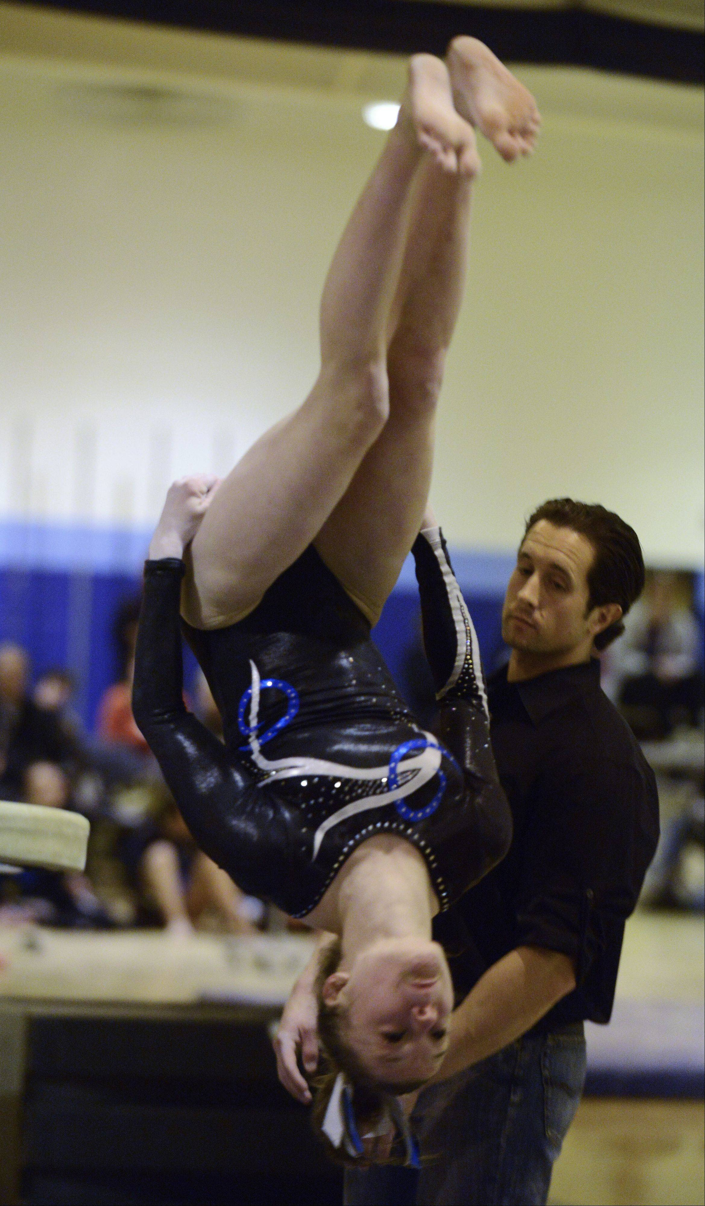 Prospect's Maddie Larock competes on vault during Tuesday's regional meet at Prospect.
