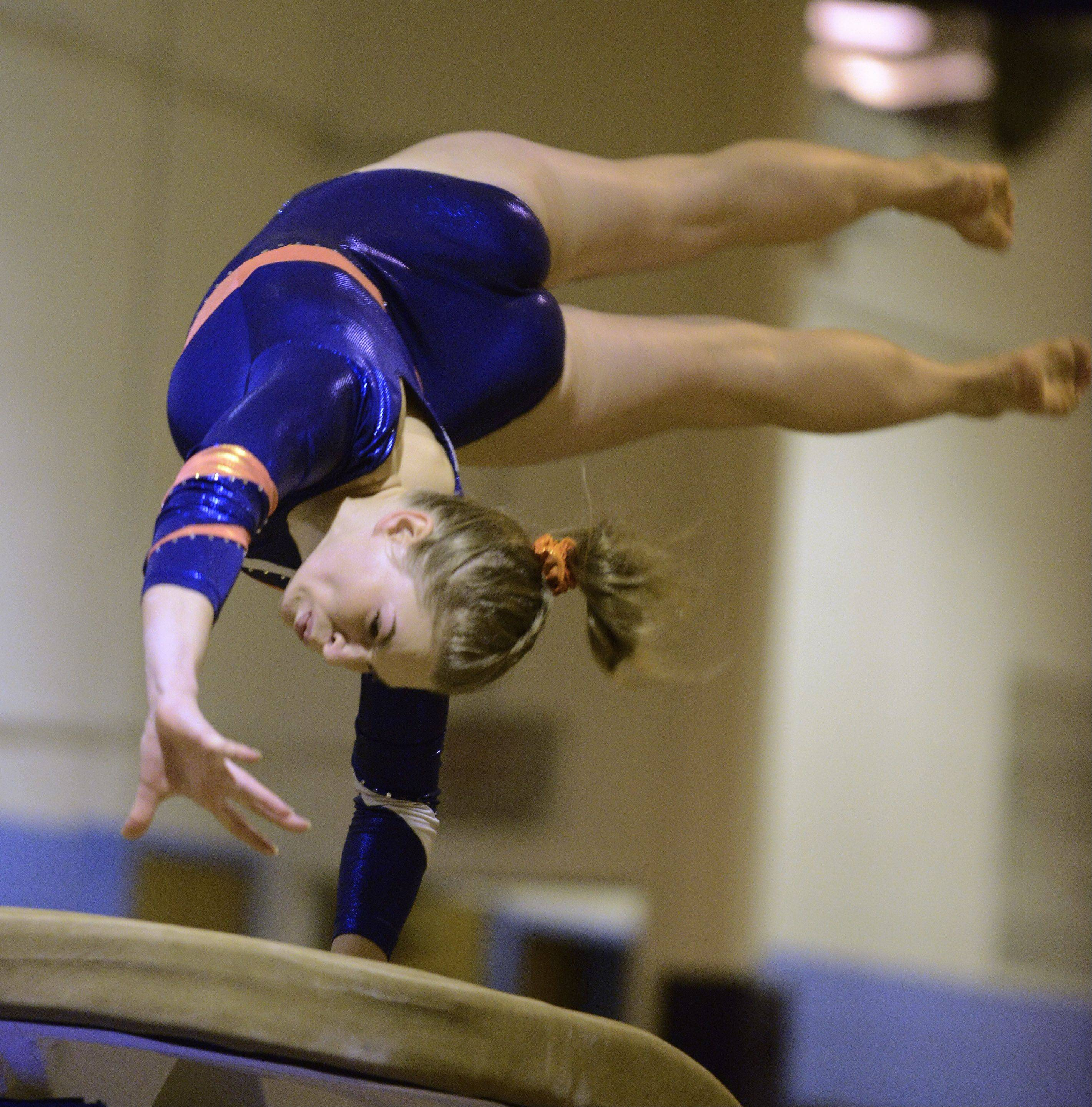 Buffalo Grove's Erika Ray competes on the vault during Tuesday's regional meet at Prospect.
