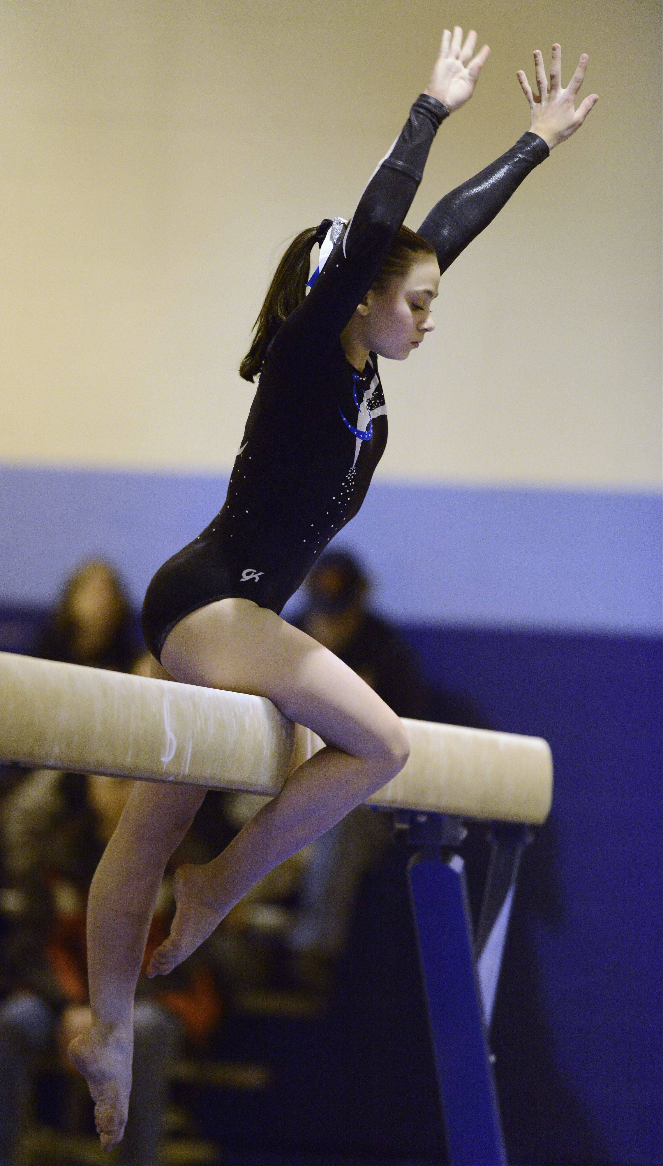 Prospect's Megan Donner competes on the balance beam during Tuesday's Regional Gymnastics meet in Mount Prospect.