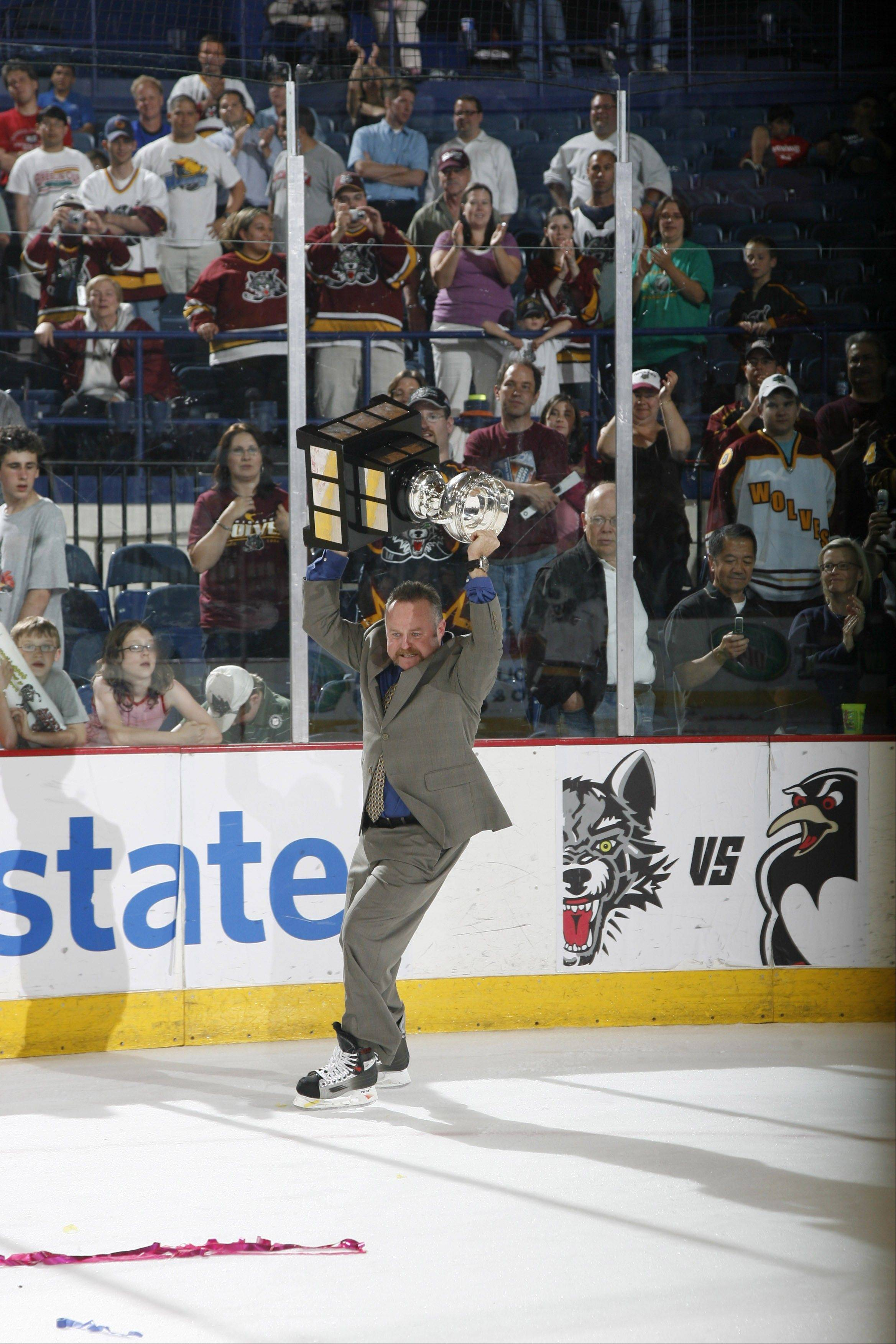 Kenny McCudden of the Chicago Wolves hoists the 2008 Calder Cup after the Wolves beat the Wilkes-Barre/Scranton Penguins at Allstate Arena to capture it.